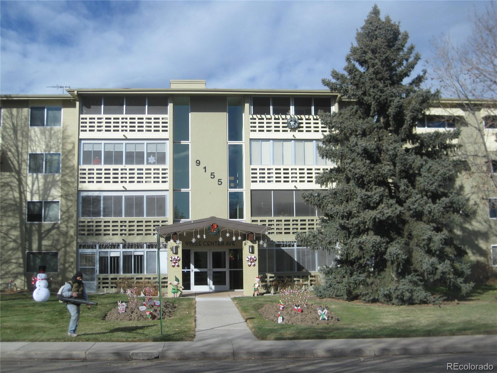 Beautifully modernized and spacious 2 bedroom plus a 3rd bonus room, 2 bath condominium.  The second bedroom serves dual purpose with an equisite built-out office and murphy bed to serve those working from home.  The kitchen has been thoughtfully remodeled to allow an open feel and boasts a kitchen island/breakfast seating. The extra bonus room/flex/work space is adjacent to the kitchen and living room.  This virtually maintenance-free home overlooks a delightful landscaped community with accommodations to stay active. There is a detached single car garage conveniently located with one opener included. The laundry is just down the hall on the same level.  In addition to the gym, there are classes and activities Monday through Saturday in the Community Center including fitness, art, dancing and many other classes along with a pool and card tables.  One of the front range's foremost 55+ communities with walking paths along the Highline Canal Trail and around Windsor Lake.  Note: Taxes are included in the monthly HOA dues.