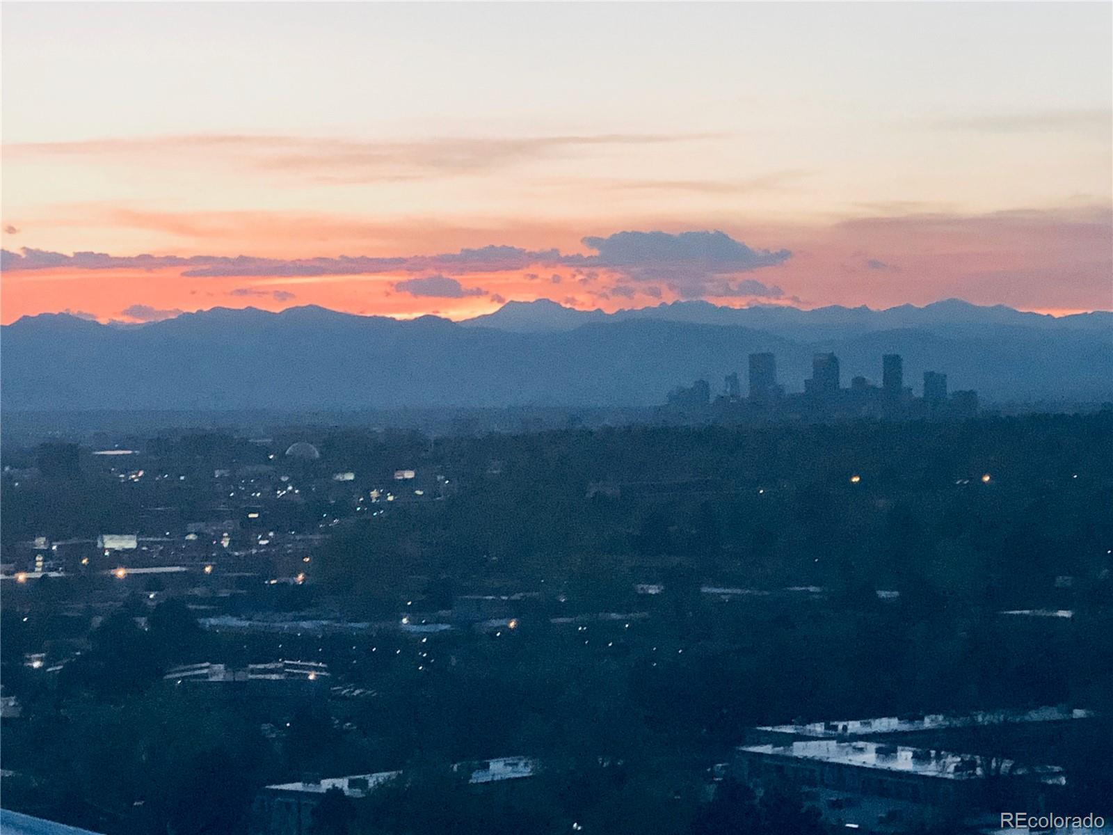 BEST VIEWS IN DENVER! This 12th floor condo in sought-after Candlewyck is light, clean and bright with both STUNNING  MOUNTAIN AND CITY VIEWS from EVERY ROOM! Floor to ceiling glass enclosed Lanai offers beautiful flex space. Wet-bar in living room. GREAT SPACE TO ENTERTAIN! Kitchen features ample counter space and cupboards and stainless steel appliances including indoor grill. Large closets in bedroom and hall offer spacious storage.  Washer/dryer in unit.  TWO dedicated storage closets, THREE PARKING SPACES and ample visitor parking. AMENITIES GALORE! Indoor pool, hot tub, steam room and sauna, weight room, billiards table, tennis courts, library.  Enjoy the outdoors with patios, gardens, fire pit, gazebos, grills and spacious grounds with walking paths and peaceful water features. Only steps away from the Highline Canal path.  Walking distance to grocery stores, restaurants. One mile from major shopping and restaurants! GORGEOUS VIEWS! AMENITIES! CONVENIENT LIFESTYLE!