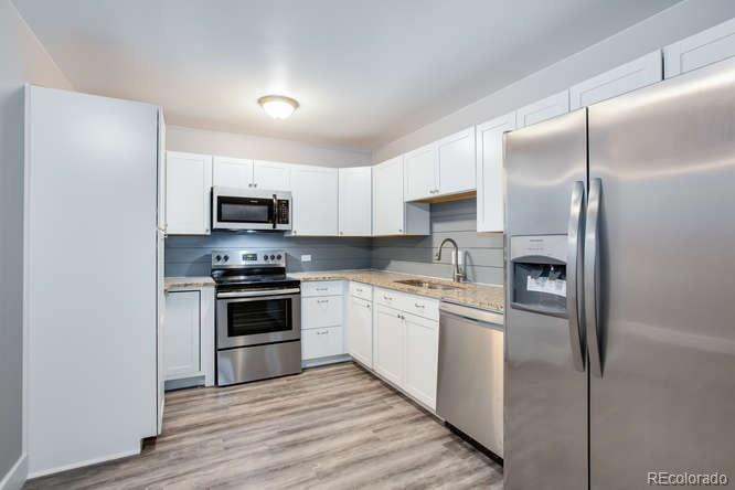 WOW, beautiful and complete remodel. New...everything. New kitchen with granite, shaker style cabinets and shiplap backslash, new bathrooms with matching granite topped shaker style vanities, new tub/shower surrounds with ceramic and glass tile, new doors throughout, new higher end laminate floors w/upgraded sound deadening underlayment, new carpet w/upgraded pad in bedrooms. Totally enclosed Lanai w/new Lanai door. New 3 tone paint throughout. Upgraded trim throughout. This one is nice and done right. Property taxes incl. in HOA.