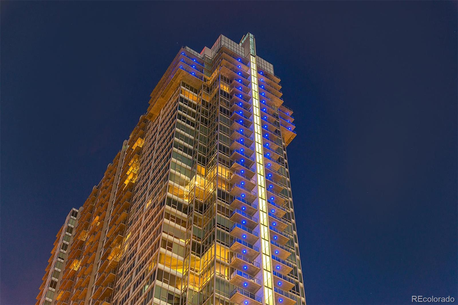Come thrive in one of Denver's most sought after premier luxury residences! See the Spire difference. Located high up on the 41st floor, this great unit offers City and Mountain views that will truly amaze. New hardwood flooring, new carpet and lighting make this unit turn-key. Everything you need is here including high-end custom built-in closets with drawers and cabinets providing an expansive amount of storage. Convenient washer/dryer in unit. Floor to ceiling windows bring in an abundance of natural light. Convenient new electric Hunter Douglas remote control shades provide privacy/lower light if needed. Access to wonderful amenities in the building including:SKY CLUB lounge, rooftop pool, hot tub, health club, multimedia lounge, theater, garage dog park, grilling areas, 10th floor event area, concierge desk, high security, and guest suites available. Theater District across the street with bars, clubs, coffee shops, shopping and just steps to light rail. The deeded parking spot on the 2nd floor and storage in the garage provides easy access and is one of the best locations in garage. This is the BEST offering for the price in the Spire. An excellent opportunity in a building with an amazing VIBE!