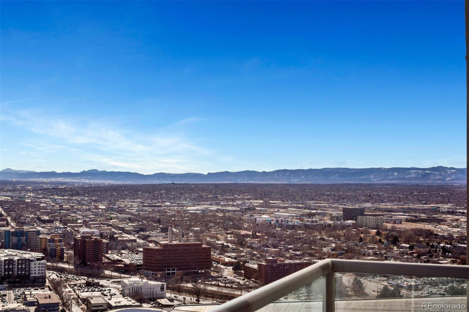 Location Location! Views! Mountain and Downtown! Urban Contemporary* Your Dream of living in the Heart of Downtown in the Prestigious Spire Building is here!! Two bedroom, Two Bath on the 35th floor with parking space and storage! The floor-to-ceiling windows frame from Downtown to the Mountains*Gorgeous features including wood floors, trendy cabinetry, stainless steel appliances, granite countertops and a five-piece master bath with walk-in closet*Frosted glass window at second bedroom recently installed for added privacy*The building amenities are amazing and only the upper floors have access to the coveted SkyClub on the 42nd floor*9th and 10th floors have Club rooms with a Theatre, Pool Table, 2 Pools, Hot tub and more* Super location in the Theater District, across from the Convention Center and the Denver Performing Arts buildings, Close proximity to all of the hot spots in Larimer Square, LoDo, Pepsi Center, Cherry Creek bike path, and the 16th Street Mall. RTD Light Rail and Bus stations are a block away*Fantastic Opportunity*