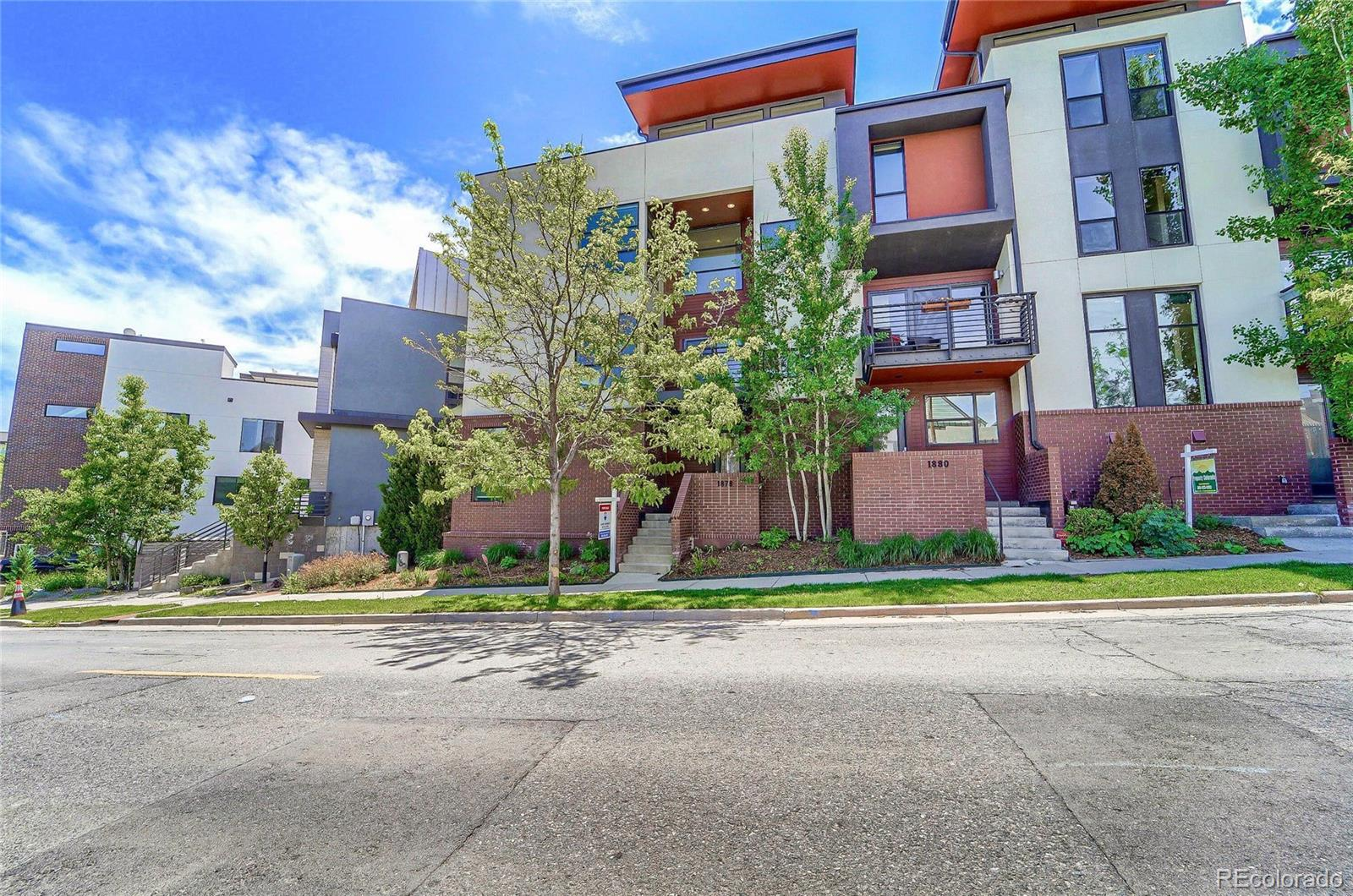 Big price adjustment on this unique Lohi residence. This home is now VACANT so easy to show!!!UNOBSTRUCTED VIEWS OF DOWNTOWN FROM YOUR PRIVATE ROOFTOP DECK!! Live the good life in your light and bright spacious contemporary end unit in a perfect LoHi location. Open floor plan to share a beverage and socialize, cook up a great meal in your modern kitchen, curl up to the TV or read by the fireplace on the open main living level. Or you may decide to enjoy the Colorado open air on the large private rooftop perch with spectacular city skyline views - or add a hot tub as it is engineered for it!  Alternatively, you can spend your evenings enjoying the neighborhood's abundant fine dining and entertainment spots all a short walk away, or walk across the pedestrian bridge to access the wonders of Downtown Denver.  Sleep well in your gorgeous master suite with large closet and luxurious bathroom. The main level bedroom makes a great office or den, and if you are downsizing with lots of stuff, the unit has plenty of storage. The 2-car tandem garage is oversize and the extra space works as a great project area and could even be finished out. This home lives large and has been impeccably maintained. Great alternative to new construction.