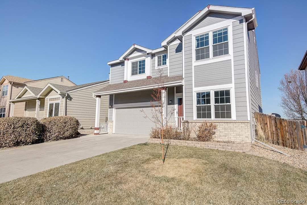 This Northglenn two-story home offers a den, gas fireplace, kitchen stainless steel appliances, master bathroom dual sinks, open patio, and a two-car garage.