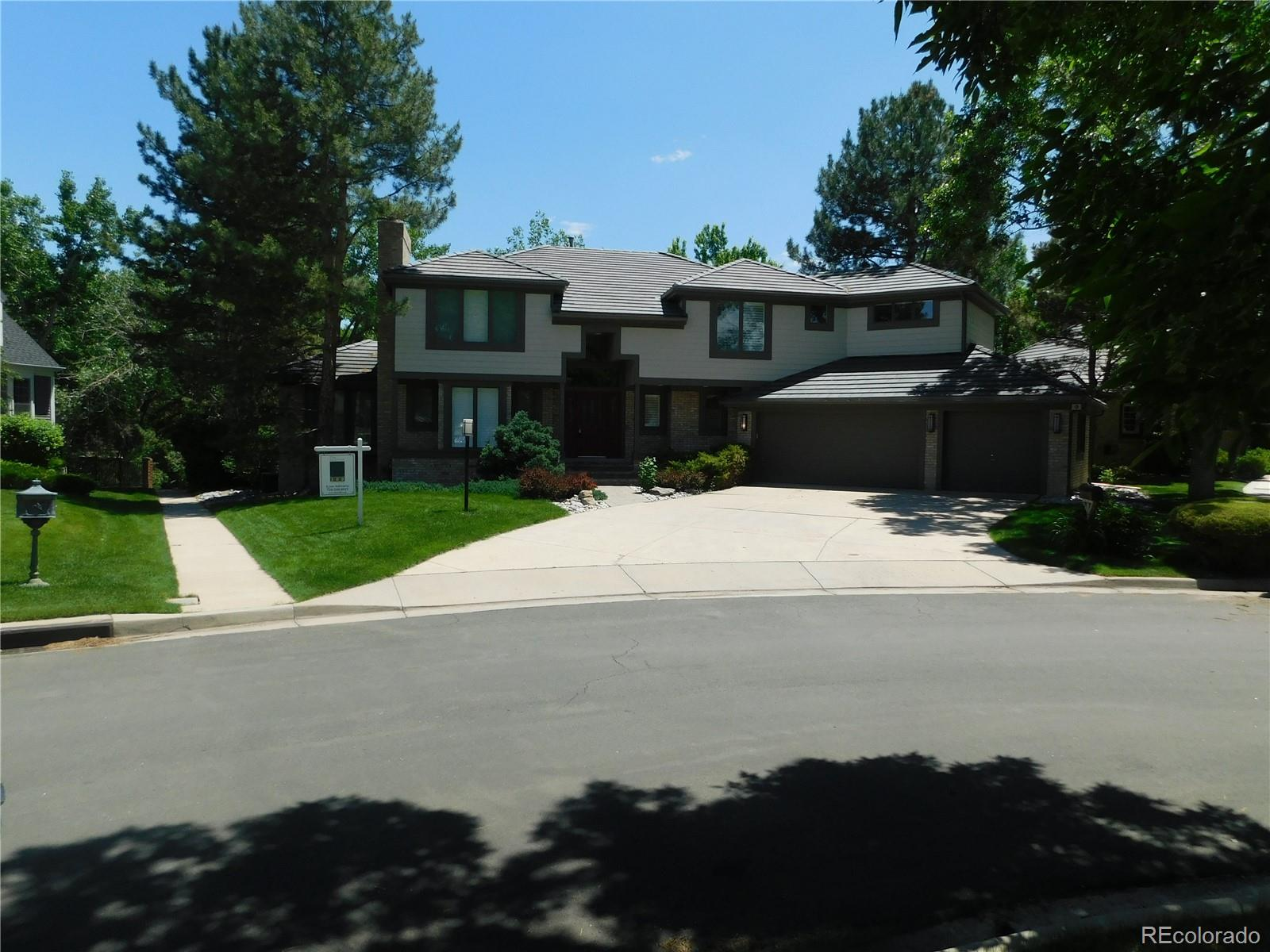 Beautiful updated custom contemporary home on a waterfront lot with mature trees located minutes from the Denver Tech Center. Features an open main floor with tall ceilings, fireplaces in the living room and family room, a bedroom/office with a covered deck and an elegant kitchen with an induction cooktop and quartz countertops. The dining room and family room open onto a second deck that overlooks the lake.  Upstairs is the master bedroom complete with a fireplace and newly renovated bathroom (2019) including heated floors and walk-in closet. An additional three bedrooms each have updated baths. The upstairs also includes an open study area with a built-in desk.  The finished basement includes a 6th bedroom (or office) complete with a full bath. The spacious living area on this floor offers lots of natural light, garden level windows and 3 storage rooms with built-in shelves and closets.  This beautiful home has easy access to active walking and biking paths, community pools / tennis courts, and Cherry Creek Schools. With no adjacent neighbors to the front or rear there is plenty of privacy to enjoy summer evenings on the decks, walking the neighborhood paths, or just warming in front of one of the property's several fireplaces. A MUST SEE!