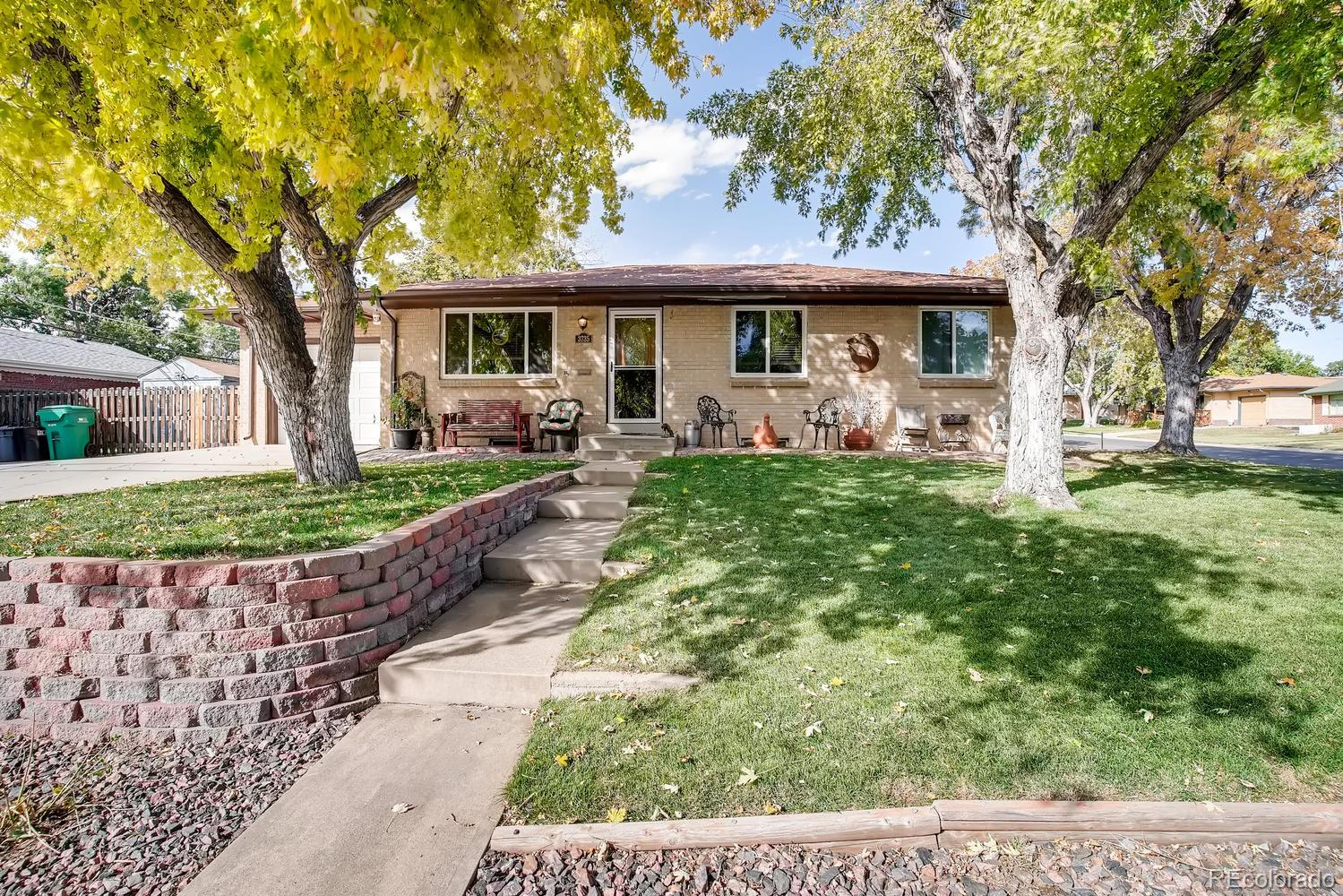 Located on a spacious corner lot, pride of ownership shines throughout this lovely brick ranch home in Rangeview Acres. The main floor features 3 beds, living room, kitchen w/breakfast nook and a full bath.  The finished basement features 2 non-conforming bedrooms, 3/4 bath, family room and laundry w/storage shelves - perfect for guests or teen wanting their own space. This home lives larger than it looks. The energy efficient furnace, central air  and ceiling fans keep this home comfortable all year long. Newer energy efficient windows & sliding glass door. The backyard shed provides even more storage space. Enjoy warm summer evenings on the deck or people watching from the front cobblestone porch.   Mature trees provide ample shade in front and the backyard gardens are sure to please. Oversized driveway pad for extra parking.  Charming inside and out.  This home is move-in ready!  It is easy to picture yourself calling this one home.  No HOA! Close to dining, shopping, entertainment and other amenities. Easy access to Highway 36.  A short commute to Broomfield, Thornton, Denver, Boulder and beyond. Don't miss your opportunity. Welcome Home!