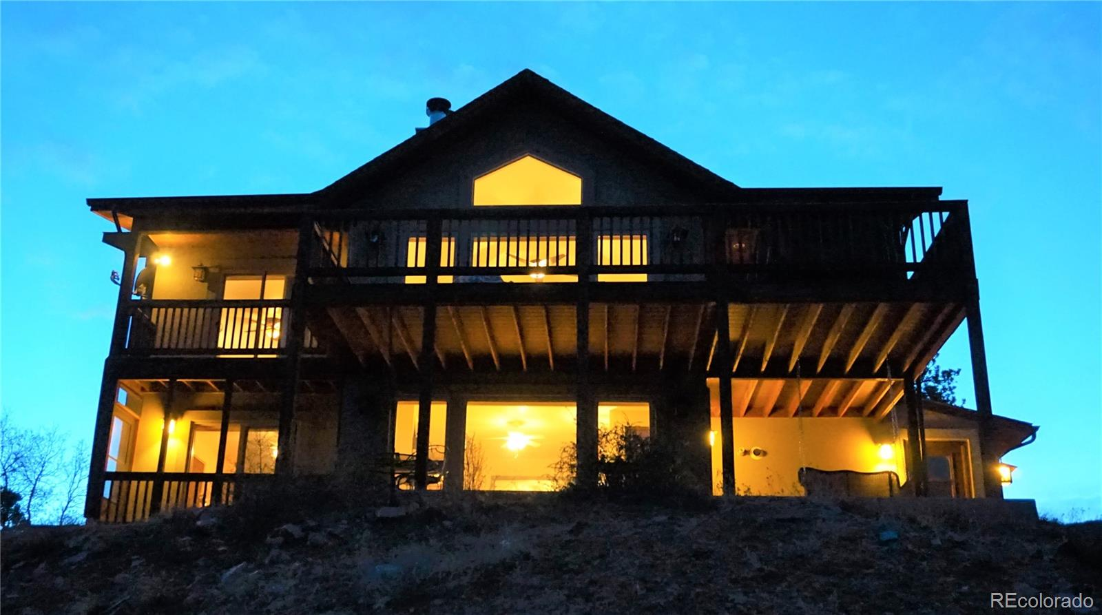 warning: zillow&realtor.com may not have correct address pinned. Priced below appraisal!! 57.4 acre Bear Trap Ranch beauty incredible VIEWS, private custom home on rugged Colorado Mountain property. Arrive on circular driveway & step onto the full length porch with trex decking. 4 beautiful fireplaces, with large stone surround in LR, beckons you inside. Newly re-finished wide plank classic wood floors with in-floor radiant heat. Stylish neutral color scheme, vaulted ceilings, recessed lighting offers classic coziness...Supplemental Remarks:      Prepare family feasts and engage with your guests in the open, well equipped kitchen featuring Jenn-Air down draft gas range facing the sublime mountain range views, single bowl sink, walk-in pantry with electric, plus convenient pantry glide-outs. Custom DR Antler chandelier and all appliances stay. Master on main features en suite 5 piece w/shower for 2, deep soaking tub, walk-in close  t with wood flooring, gas fireplace, sitting area, balcony, more incredible views.You'll find artist stained architectural interior doors, high-end champagne fixtures throughout. Custom soft close built-in cabinetry throughout + great storage in mud room from garage. Hunter Douglas shades throughout. Custom features at every turn. Buried propane tank and electric lines, built-in safe. Over-sized 2 car garage w/ lovely wood-look arched doors. No maintenance stucco siding! RV parking + up to 10 parking spaces for your guests. 360 views galore at this Colorado mountain retreat. Peaceful enjoyment, wildlife, awe inspiring views from one of 5 trex porches, 4 covered, 1 all season porch. Whether you enjoy nature, rappelling, birding, hiking, are a hunter or the mountains are simply calling, you'll find plenty to do here at this mountain oasis... this breathtaking property will always welcome you Home. Envision your new beginning here today!