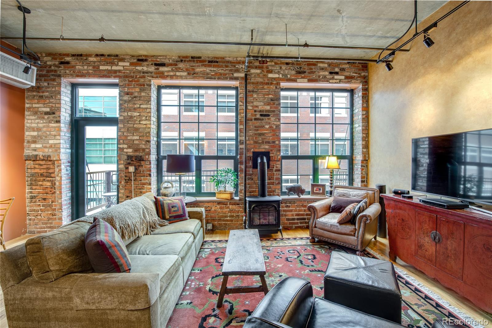**VACANT, BEAUTIFULLY STAGED AND READY TO SHOW** Beautiful loft in the Historic Ice House Lofts. The best location for everything LoDo and Downtown has to offer. Sports venues, restaurants, cultural events, train to the plane, Union Station (Denver's living room), McGregor Square, Cherry Creek Path, and more. 1 bedroom (very large), 1 bath, open floor plan with living area, dining area, great kitchen with large island for entertaining, and a Virginia Stove fireplace. Balcony with a sweeping mountain view. 1 parking in the garage, and 1 storage unit. Exposed Brick. Large windows across one end of the loft. A very good one-bedroom at the Ice House, probably one of the best. The building has great amenities. Full-size fitness room with up to date equipment, rooftop deck to enjoy the views, entertain or just hang out. Don't miss this one. If you want to be downtown this is the place to be.