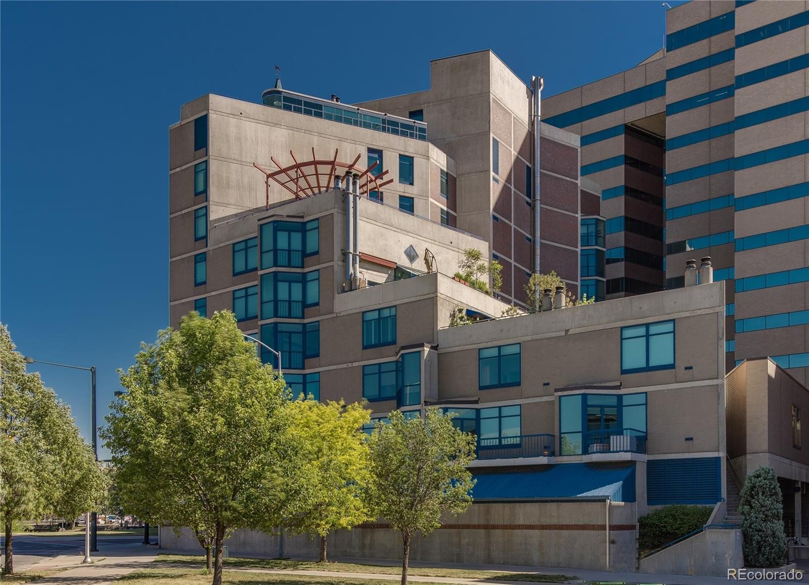 WOW, 2 stories, 2 bed, 3 baths, 2659 sq ft open-concept condo with incredible 360-degree views of the front range mountains and city lights, overlooking Cherry Creek Trail and Auraria Campus. Amazing location steps from Larimer Square, the Denver Center for Performing Arts, and more. Great natural light from the floor to ceiling windows with plantation shutters. Gorgeous custom built-ins, hardwood floors downstairs and new top-quality carpet upstairs with huge open office, a laundry room sized for a full-sized washer and dryer and a wet bar with a refrigerator in the den. Plenty of storage space with large closets and a walk-in pantry. There is elevator access to both floors (common area) of the unit and the building's large common area terrace where you can grill and entertain is literally across the hall! The unique architecture cannot be matched anywhere in Denver. Comes with deeded parking spaces in the secure garage, where there are also 2 dedicated storage units. For views alone, this one deserves attention.