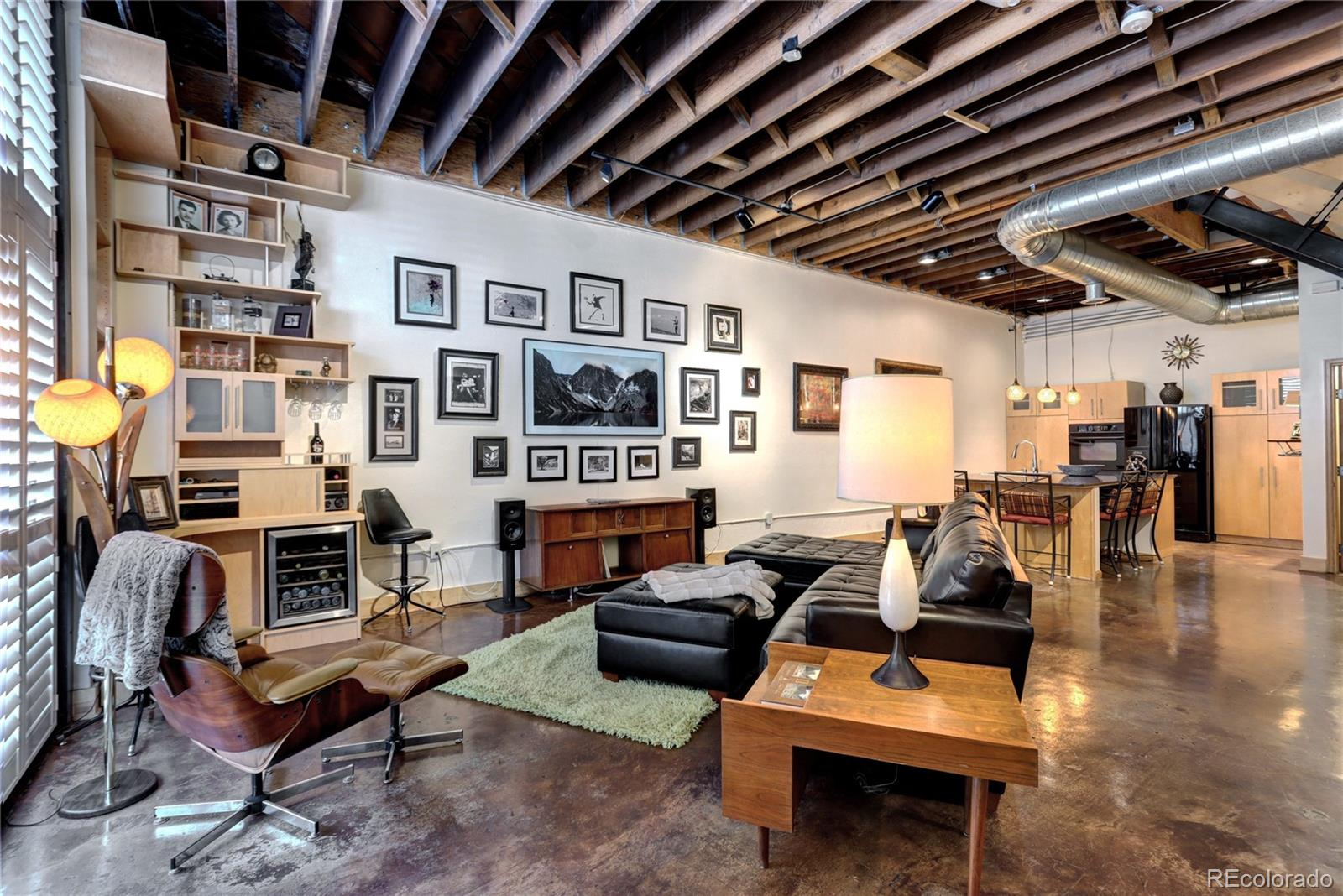 "Very unique, one-of-a-kind loft. In 2001, the Furniture Factory was converted to these spacious lofts/rowhomes. Open main floor concept, with custom built-in bar, cabinets and desk/office space and stained concrete floor. Huge kitchen island, perfect for entertaining. The 2nd floor has master bedroom, 2nd bedroom and remodeled, full bathroom. Original wood floors and 11' rafter ceilings on main and 2nd floors. The master bedroom has custom, built-in library, with hidden closet, if more space is needed. The 3rd floor has the 3rd bedroom, with laminate floor, along with a large, rooftop patio, with mountain views...an amazing outdoor space! All interior doors are 8' tall and solid wood. 6"" wood baseboard throughout. Recently painted interior. Custom plantation blinds. Close to RiNo, Coors Field, LoDo, dining, bars, historic art building and minutes to Pepsi Center and Mile High. One secure garage parking space #4, with 8'x10' storage above it. A second secure off-street, reserved parking space (#4). Zoned mixed use, so you can work and live here!"