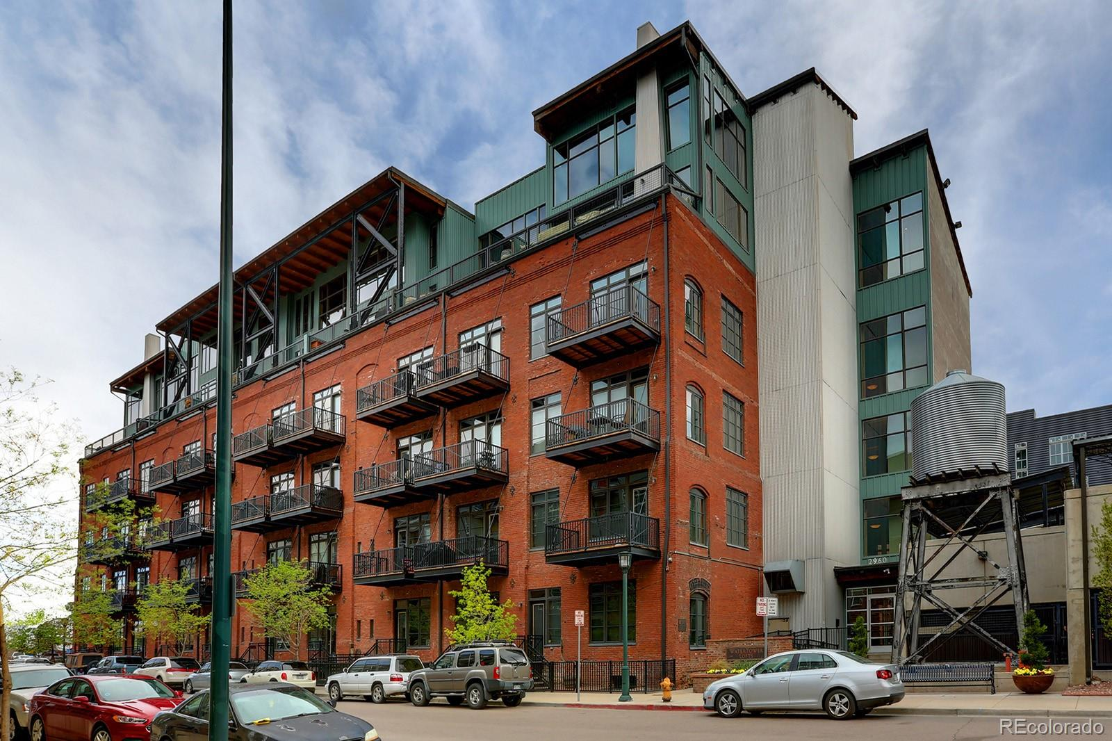 Gorgeous 2 bedroom 2.5 bathroom loft in the historic Watertower Lofts. Located in one of Denver's most desirable neighborhoods—walk to Coors Field, restaurants, grocery stores, light rail, Union Station and so much more. Upon entry, one is welcomed by soaring 13' high ceilings, exposed red brick, impressive timber beams, and hardwood floors. The open floor plan interlaces the entirety of the living space for optimal functionality and flexibility. The gourmet kitchen with its granite island provides the perfect setting for entertaining family and friends. Main floor bedroom features a full bath (his and her sinks) and a stackable washer and dryer. Large walk-in closet with a custom Elfa closet system. The bedroom can easily accommodate a king size bed and/or be converted into a living area. Lower level features a large living area with full bath (his and her sinks and another large walk-in closet). It can easily be converted into a master suite. Amenities include a fitness center with up to date equipment. Includes one parking space and storage locker. Walk out your back door to your own fenced courtyard. Great for BBQ and entertaining. Easy access to I-25 & I-70 and Confluence Park, Cherry Creek walking and bike path.