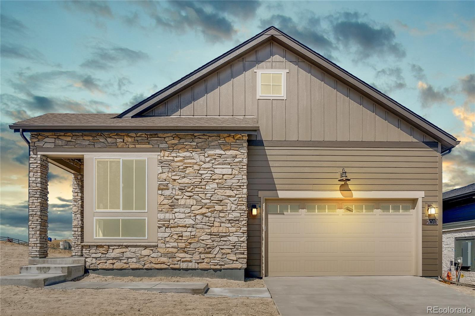 """Available in April/May 2020.  Gorgeous Legends ranch plan in The Canyons features 3 beds, 3.5 baths, kitchen, great room, study, finished basement w/wetbar and 2 car garage.  Great room with fireplace with full height tile and mantel. The kitchen features an island, walk-in pantry, 36"""" GE Monogram stainless appliances with refrigerator, Concerto quartz slab kitchen counters with a backsplash, and Aristokraft Lillian Purestyle White and Landen Maple Flagstone cabinetry. The dining room is conveniently located off of the kitchen - perfect for entertaining. The master bath features a barn door and framed mirrors. Other gorgeous design finishes include Vigor Oak wood-style laminate floors, craftsman chair rail w/iron balusters and a finished basement with a wet bar that includes a sink, refrigerator & dishwasher. Enjoy warm summer evenings on the covered patio off of the great room. Don't miss your opportunity."""