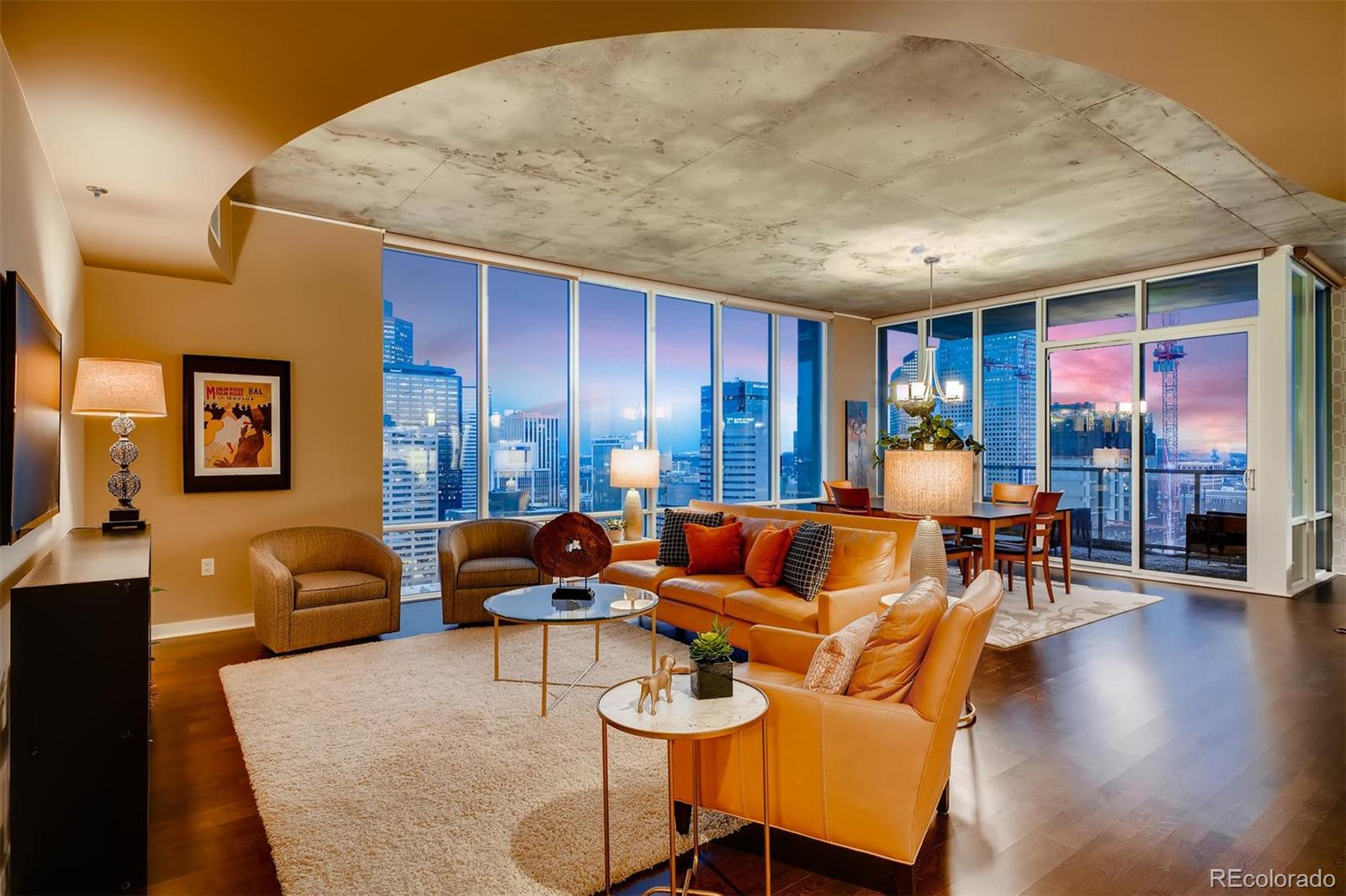 """ALL FURNISHINGS & ACCESSORIES (EXCEPT A FEW STAGING ITEMS) INCLUDED AT THIS PRICE!! SPECTACULAR VIEWS IN A CORNER HOME! Step into this gorgeous SPIRE home perched 34 stories above Denver, with all of downtown at your feet. This spacious 2-bedroom/2.5-bathroom corner condo has nearly 1,700 square feet of contemporary living space in a wide-open floor plan with tons of natural light. Plenty of privacy with two bedrooms on opposite ends of the home. """"This is my favorite floor plan at SPIRE"""" is a frequent comment made by guests and residents alike. Special features and upgrades include beautiful hardwood floors, new carpeting in the bedrooms, Hunter Douglas shades, ceiling fans, motorized shades, electronic thermostats, granite countertops, stainless steel appliances, contemporary wallpaper accents, and new custom cabinetry in the built-in bar area, featuring a wine fridge. TWO LARGE BALCONIES and access to the exclusive 42nd-floor SkyClub lounge make this home a rare find at SPIRE! Also included: 1 deeded parking space in a prime location and 1 storage space in the attached garage. All seller-owned furniture and furnishings are available for an additional fee. You'll want to view this residence twice to truly appreciate the jaw-dropping views – once by day and once at night. The highly-desirable 42-story SPIRE is LEED-certified w/40,000 square feet of resort-like amenities, including a rooftop pool (heated and open year-round), a hot-tub, extensive health club, The Zone multimedia lounge, Box Office home theater, garage dog park, yoga garden, outdoor grilling area, 10th-floor private event lounge, 24-hour courtesy desk, furnished guest suites, modern security and access control systems. Very well-maintained building. SPIRE Denver has fast internet coming soon--1 gig dedicated to each condo. Fastest downtown! Come home to Downtown Denver's SPIRE -- life is better here!"""