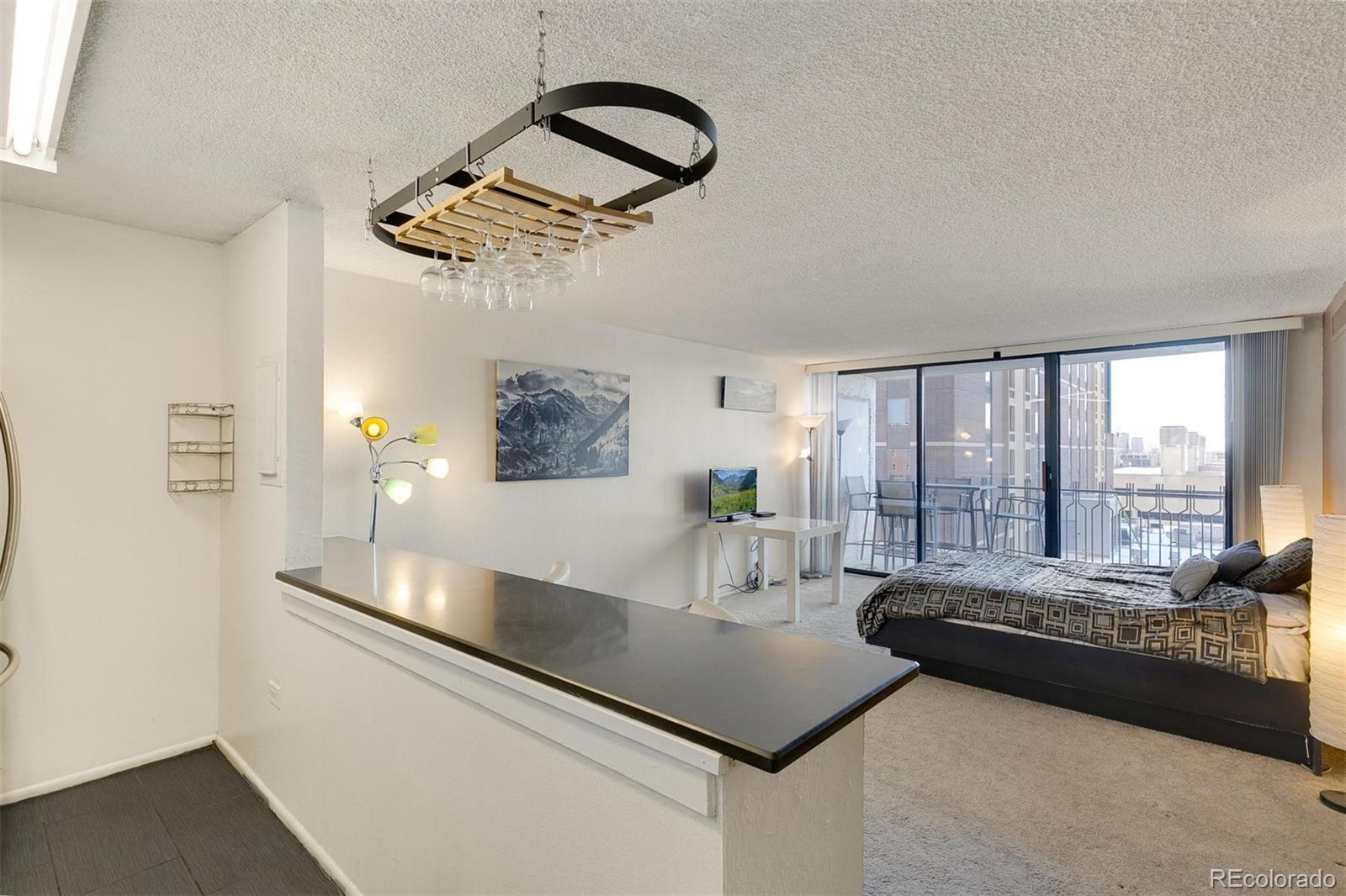 Studio for sale in the heart of Downtown Denver! This unit features a fully remodeled kitchen with new cabinets, quartz countertops, breakfast bar, stainless steel appliances, and tile floor. There is a walk-in closet featuring built-in shelving with plenty of room for storage. Unit has a balcony with beautiful views of the rocky mountains that doesn't face a street. Walk to 16th Street Mall, Pepsi Center, Union Station, Denver Performing Arts Center, Coors Field, bars, restaurants and much more! Building features outdoor pool and rooftop patio, fitness center, conference room, and laundry room. Urban living at an affordable price.