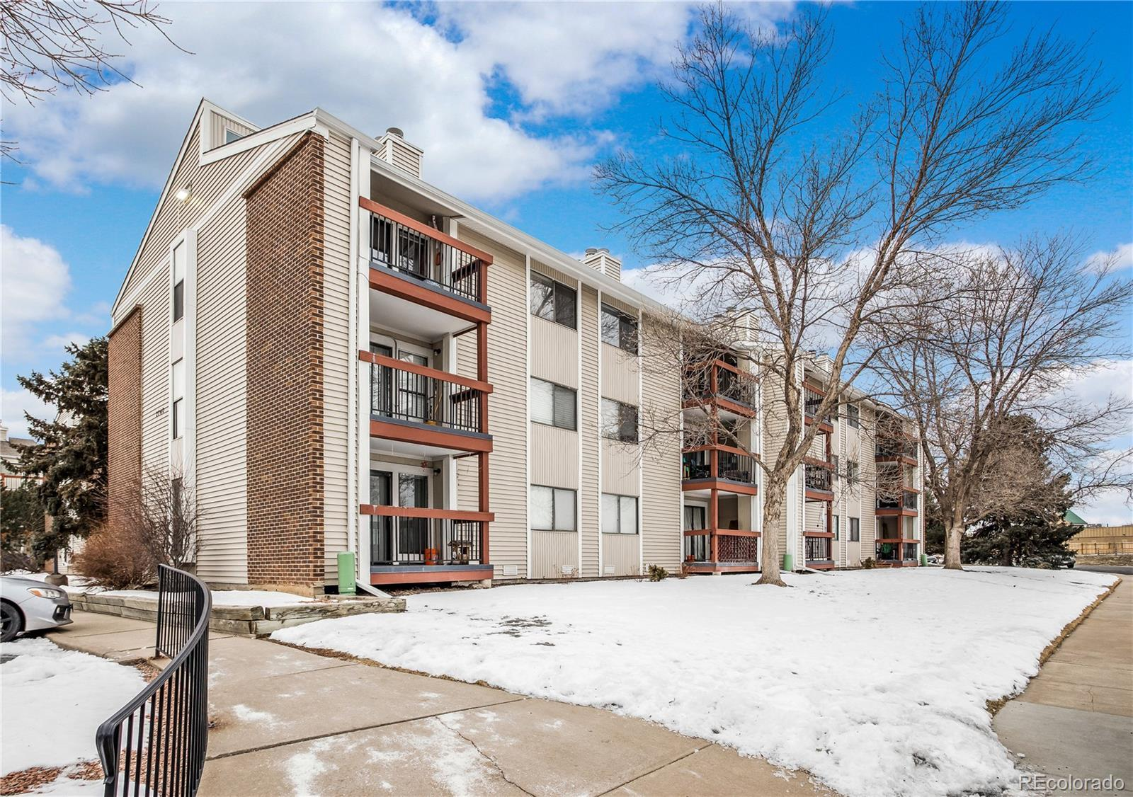 Wonderful remodeled ground floor 3-Bedroom with mountain views*Updated kitchen offers white cabinets with modern hardware, new countertops, new stainless steel sink & faucet*Both bathrooms offer stylish new vanities with marble countertops*Inviting family room with cozy wood-burningfireplace and new slider patio door leading to private balcony with mountain views*Master suite with attached 1/2 bath, large closet & mountain views*Kitchen appliances & washer/dryer included*Newer electrical panel, furnace and central A/C*Fresh paint throughout*Permit parking for two cars plus plenty of street parking with easy condo access through gate on balcony*Great storage in the crawl space accessed through hallway closet*Community playground, tennis and basketball courts directly across the street*Great location with easy access to Highway 36, I-25 & multiple light rail stops*Tremendous value for a 3-bedroom*Come see it before it's gone!