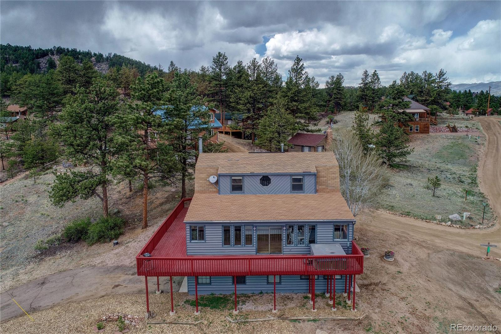 This 3 bed, 3.5 bath home would make the perfect vacation property or permanent residence. Amazing views of Pikes Peak can be enjoyed from the large deck. Separate entrance downstairs makes for a great investment opportunity. HOA dues include water, trash, use of the community building, private fishing and road maintenance in this gated community.  The subdivision backs up to Pike National Forest with several hiking trails available.  Eleven Mile Ranch is  just outside the entrance to Eleven Mile Canyon with gold medal fishing waters, hiking trails and camping. Several ATV trails are nearby.  Just over an hour to Breckenridge and 30 min to Woodland Park make this the perfect location.