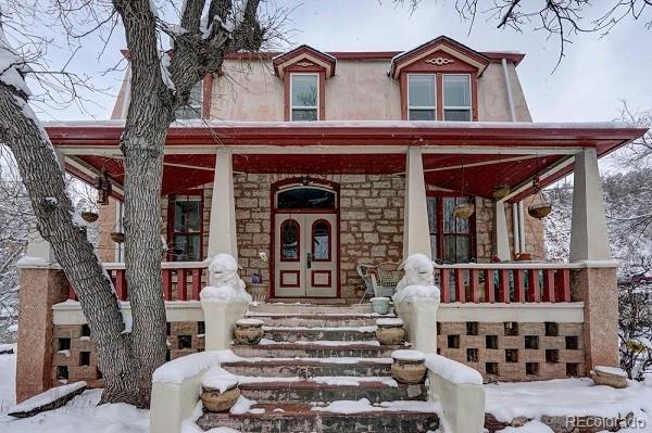 Own a piece of history while making an investment in your future.  This timeless historical Second Empire home built in 1875 is one of 150 properties evaluated by the City of Manitou's Historic Preservation District. This home has 5 individual apartments with their own kitchen and baths making them convenient and self-sufficient.  Currently occupied by 4 long-term tenants and 1 owner occupied you have a built in revenue stream with the potential for more.  Residences could be short-term rented pending City of Manitou approval. Two traditional lion statues greet you on your walk up to the grand entrance of the home.  Upon entering the beautiful foyer boasts an original staircase leading to three apartments on the second floor and two on the main floor.  Located on .41 of an acre this property is one of the largest lots in the area with a lush green lawn, tall mature trees, and off-street parking. Your tenants and guests will enjoy the wonderful views of Pikes Peak while sitting under the pavilion located in the backyard of this Colorado oasis. Downtown Manitou Springs is within a short walking distance away which offers something to enjoy for everyone. If that isn't enough Colorado Springs is only a few minutes away! **Please note for the privacy of the tenants only the owner occupied apartment is being shown in photos. Please schedule a showing with your broker or the listing agent of this property to see the other four units.**