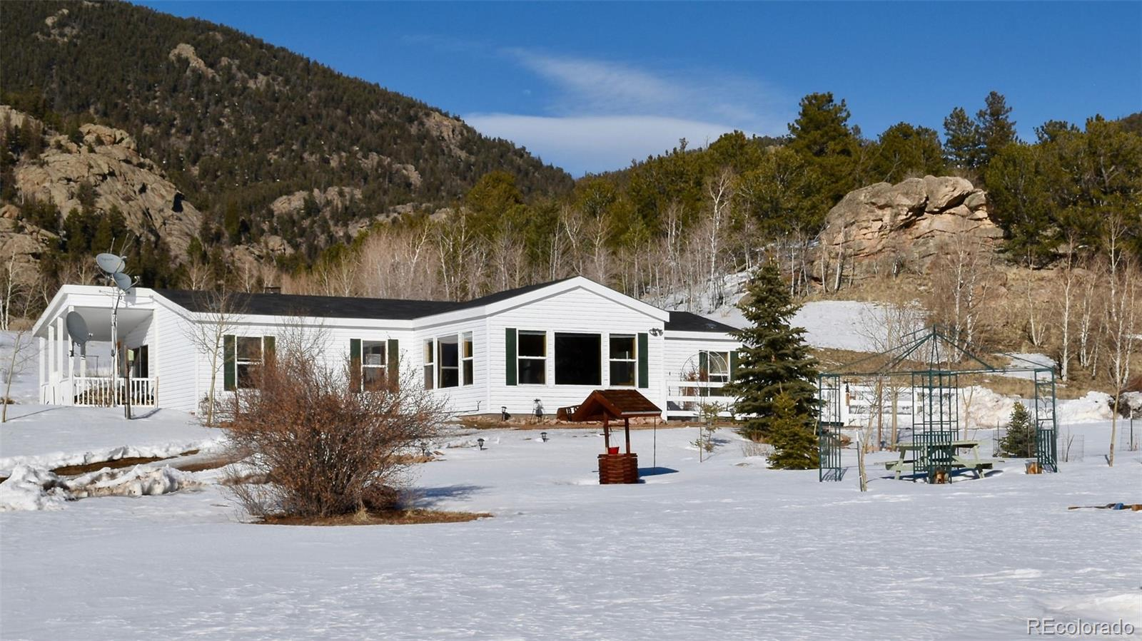 Welcome to your Authentic Colorado Lifestyle! Pride of original ownership is evident throughout! (Property is being sold furnished except for Master Bedroom and Sunroom furniture.) Beautiful ranch-style home with amazing 360 views w/ rock outcroppings. Tiara subdivision is tucked away just off paved roads where you will enjoy views of 39 Mile Mountain, 11 Mile Reservoir, the Sangre de Cristos Range, Collegiate Peaks & Spinney Mountain as you make your way to your cozy mountain retreat! You will love the warm and inviting sunroom! New carpet throughout! Bring your ATVs, RVs and boats! Lots of space for parking your toys! Hiking and OHV trails nearby. Imagine being 5 minutes from 11 Mile Reservoir where year around fishing is the norm! Wildlife abounds with Rocky Mountain Big Horn Sheep and an occasional donkey whose ancestors came from the gold mines of Cripple Creek & Victor! Keep your camera and binoculars nearby as wild turkey, bear and deer also frequent the area. The oversized garage has clear panels that allow natural light. You will love the abundance of storage, shelving, workbench and refrigerator all of which are included. This beautiful mountain rancher can be your retirement, seasonal or full-time residence. Perfect VRBO or Airbnb! Live the Life You Have Imagined!