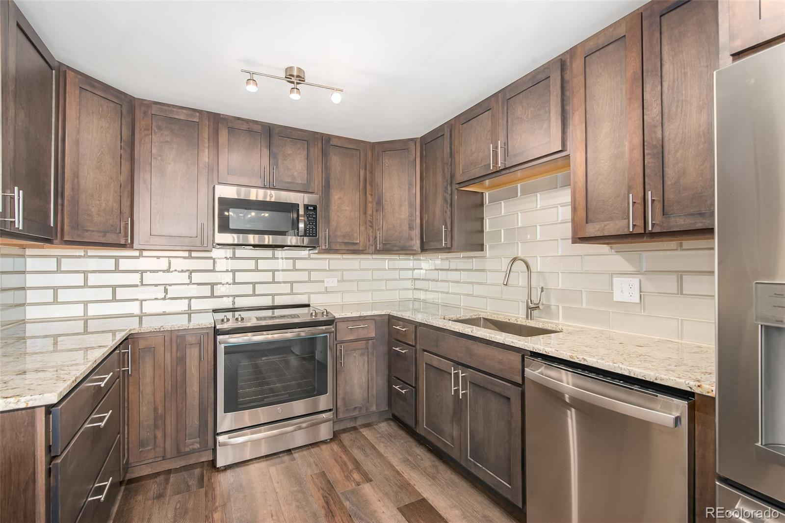 Professional interior designed remodeled unit in 55+ community for active adults. Kitchen with new soft close cabinets, custom tile backsplash, slab granite countertops, brand new stainless steel appliances and island. Living room with new carpet, ceiling fan and new room AC unit. New LED lighting throughout. Enclosed porch provides additional living space year round. Completely remodeled designer bathrooms. Master bedroom with walk-in closet. Large closet provides additional storage. Highest quality finishes - you won't be disappointed. Detached garage just outside the building with additional storage.