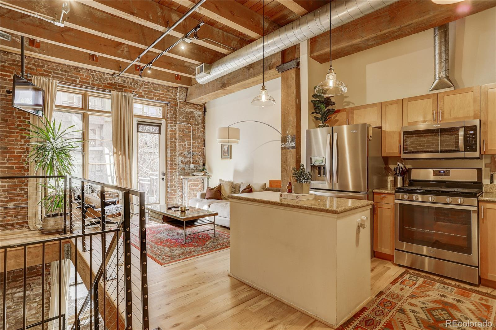 Beautiful and unique Watertower Loft!  Lives like a brownstone with entry directly into the unit from Inca. You are immediately welcomed by an open living room with character from floor to ceiling. Exposed brick, original wood beams, and soaring ceiling heights paired with all the modern amenities make this the perfect downtown home!  As you make your way into the open kitchen,  you'll love hosting your guests around the island or just around the corner for a dinner party. You'll find your first full bathroom, off the dining room.  In-unit washer and dryer and extra storage are tucked away from the living / hosting space and simplify downtown living. Next, you'll walk down the exposed staircase to the second oversized living room. This room has endless possibilities;  an office, room for your pool table, or a media room? Finally, you enter the oversized master suite complete with a second full bath, walk-in closet, and workout room or den. 