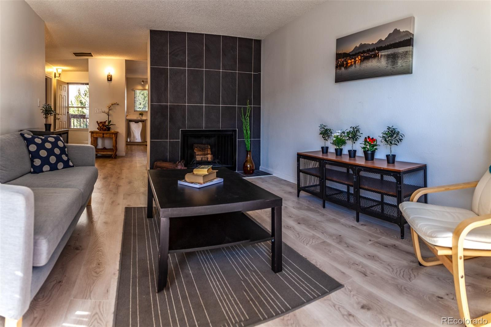Come check out this beautifully updated condo today! Beautiful new engineered hardwood (10 mil) runs throughout the kitchen and the living areas. The kitchen has been transformed with new floor-to-ceiling cabinets, new counter tops and stainless steel appliances.  Off the kitchen you'll find a cozy dining area. The living room has tons of natural light, a freshly faced wood-burning fireplace and a sliding door leading to the back patio. A HUGE bedroom sits off the back of the unit, complete with a large walk-through closet with access to the bathroom. The updated bathroom boasts new tile and vanity, and is accessible from the living area or the bedroom. In-unit laundry with stackable W/D included. All-new fixtures and lighting. Blue Ribbon Warranty Gold Plan Through May 23rd, 2020. Furnace & AC serviced and checked in May 2019. Wood-burning Fireplace Just Cleaned & Serviced. New H.W. Heater 2019. Exterior HOA renovations are completed now (Decking, Siding, Etc.) . This building and the complex has a cleaner and fresher look now. Brand new housing/mixed use development going in near 84th and Federal. Good access to the highways. Come take a look today- it won't last long!