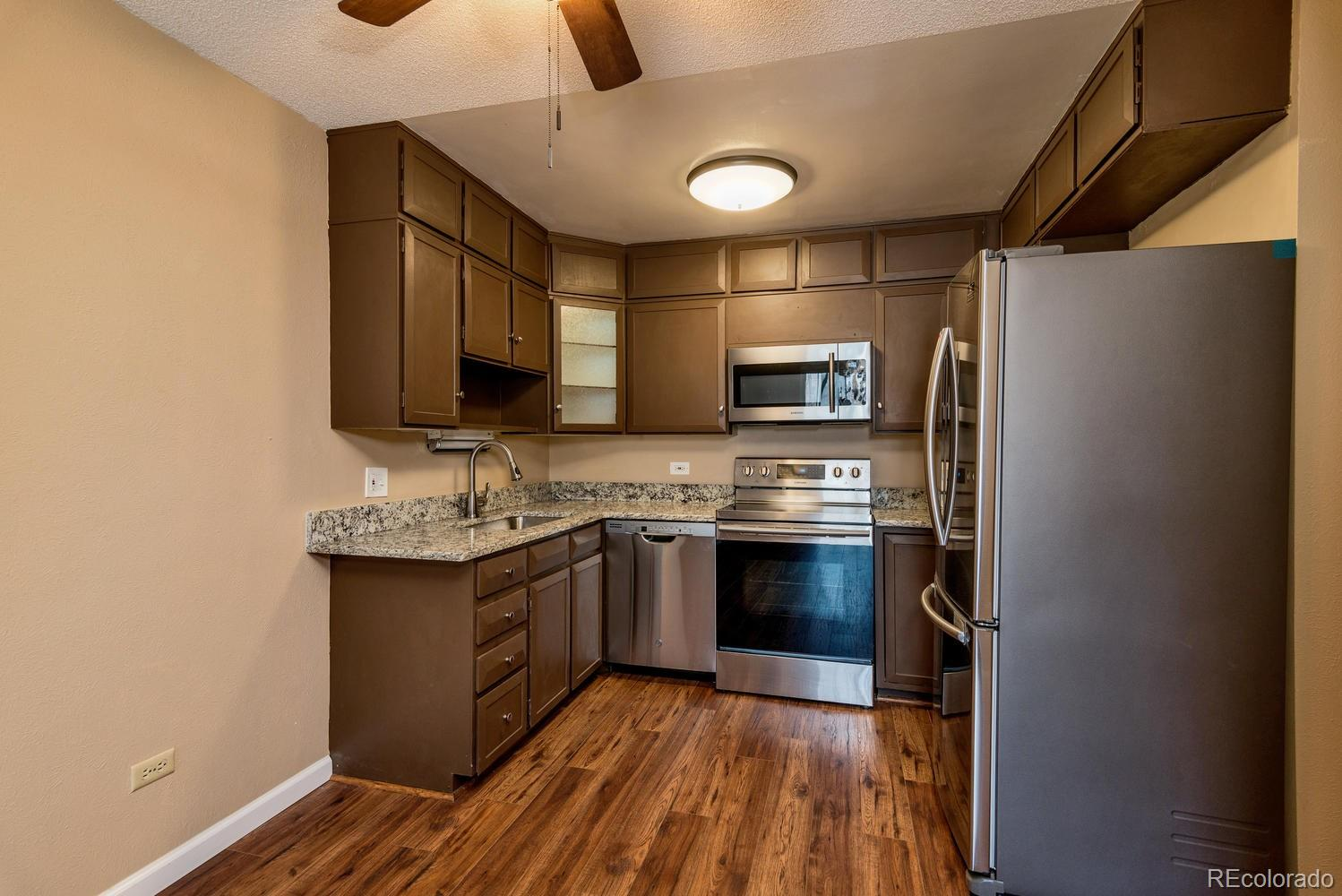 Spacious and updated, this condo is a must see!! *Tour Windsor Gardens Online: Community tour, explore amenities and features, check out examples of interior walking/narrated condo video tours, and more:  go to www.tourwindsorgardens.com * Move right in and enjoy this 1380 sf condo in much desired and beautifully maintained Windsor Gardens !!  This condo features 2 bedrooms, 2 bathrooms, plus a bonus den! 1 car underground parking space included!!! Additional underground garage available for purchase. Great location steps to clubhouse and all the amenities this community has to offer. Kitchen features granite slab countertops, new stainless steel appliances included! Bathrooms with new sinks, faucets and granite slab counters. Laminate wood floors throughout main area- kitchen, entry, and den. Newer neutral paint tones throughout. New Carpet in bedrooms! Master features en-suite 3/4 bathroom, and a large walk-in closet. 3 wall a/c units. Lanai features water resistant laminate flooring, glass/screen enclosure, and 2 vinyl slider doors. Bonus storage room on same floor. Colorado's largest active adult living community, age 55+. FHA/VA approved. HOA Dues include annual property taxes! And also heat, water, sewer, trash, 24-hour patrolling community responders, club house w/indoor & outdoor pool, hot tub, sauna, activities...9 hole par 3 golf course open to the public.