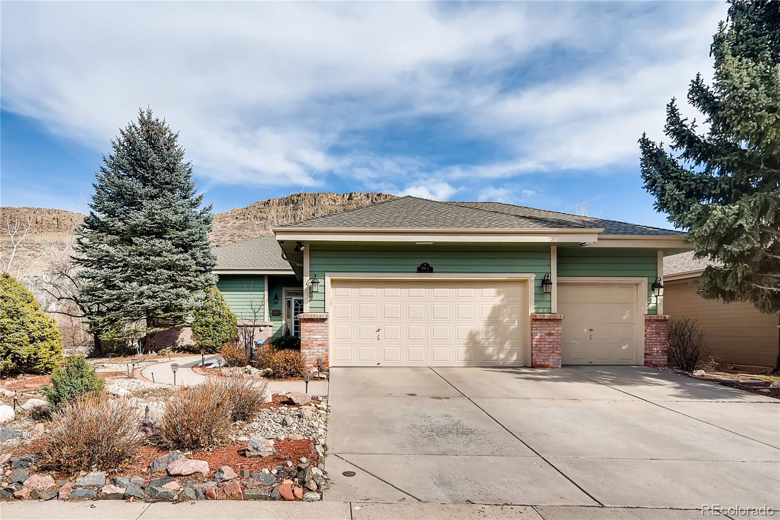 Sellers are motivated to sell, found another home . This amazing Home located in the heart of Golden. Walking and Bike Riding along the path in your backyard awaits you. This home has been updated from head to toe. You will love the xeriscape yard with lots of beautiful flowers that come out in the spring. There are fruit trees and beautiful greenery throughout the property. Small garden area for those of you who have a green thumb and want to grow your own. The Kitchen is a Chef dream. Viking appliances with top of the line newly installed cabinetry and custom lighting throughout and the beautiful granite on the custom island and back splash is over the top. Double sided fireplace is in the kitchen and living room. The master is secluded and the stand alone tub will transport you to a paradise. Custom Shower with high end fixtures and tile. Walk in Closet. This home is great for entertaining with an open floor plan and inviting deck with mountain views. Home theater (including screen and furniture are included) and exercise room will enhance you lifestyle, all equipment included.