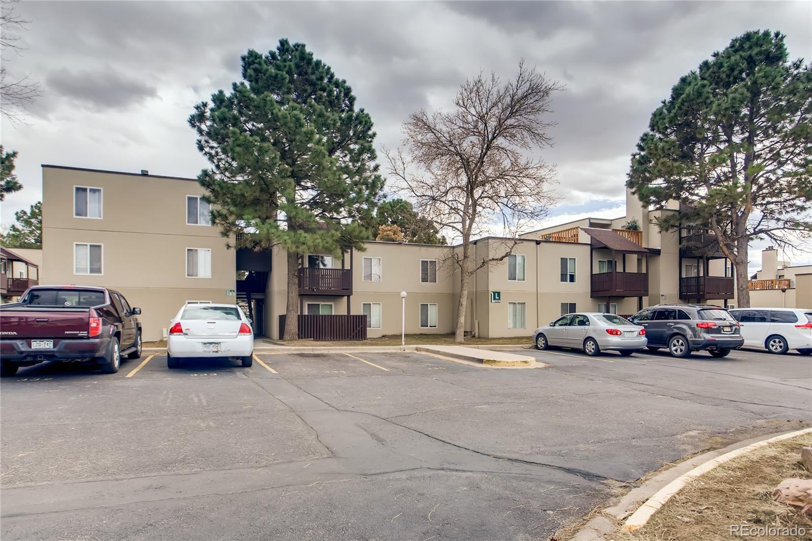 Ranch-style low-maintenance condo offers a chance to break free from increasing rents and become a homeowner! It's no frills, but sweat equity can create your Home Sweet Home. Good size family room has authentic wood-burning fireplace. Galley kitchen features tile floor and includes fridge, oven with cooktop, microwave and dishwasher and ample counter space, cabinets & pantry. Master bedroom has a triple-width closet & private bath. Second bedroom is serviced by full 2nd bath that was recently remodeled. Family room includes access to covered patio with privacy fencing by shady tree, providing a quiet place to sit outside as spring approaches. In-unit laundry puts an end to schlepping to the Laundromat. This main-floor unit has no stairs and is handicap accessible. 1 parking spot in lot. Community pool. Walking distance to bus and High Line Canal Trail. Easy walk to any number of businesses, for coffee and a donut, or a job. Minutes to parks and delicious eateries from around the world. Minutes to highways. A great choice for a single buyer, couple, small family or roommates!