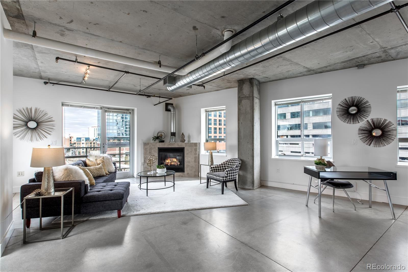 This uber cool, sophisticated, urban loft has a unique layout – different than the other residences in one of Riverfront's premier buildings, Park Place Lofts! It has a gas fireplace, which is super rare, and lots of extra glass so it is flooded with light! Terrific master suite with a HUGE closet and five-piece bath. The balcony is perfectly positioned to optimize views.  The patio also has a gas stub for a gas grill. The large, open kitchen has stainless steel appliances and a GAS stove along with plentiful cabinets.  The polished concrete floors and exposed mechanical systems and concrete ceilings create a backdrop for any style of living - from traditional to modern. Located at the foot of the Millennium pedestrian bridge you will find yourself within walking distance to hundreds of restaurants, shops, bookstores, Union Station, the Ski Train, art galleries, gyms, Whole Foods, lightrail, parks and the footbridge to the Highlands! All the best that Riverfront Park, Union Station and LoDo has to offer!