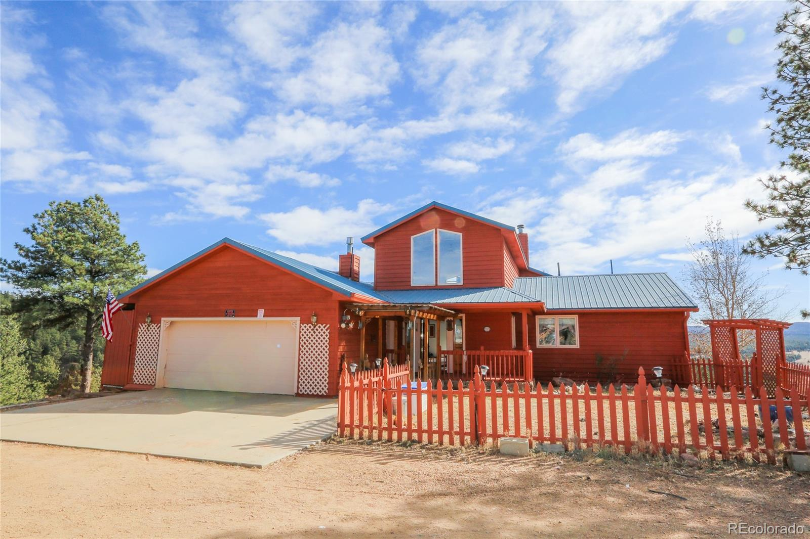Views, Views and more Views - this beautiful 1.5 story 4744 sq ft home sits on 40 gorgeous acres. Location is not too far from Hwy 24, zoned A-1 and no covenants. Walk into the home and you are greeted by a wall of windows in the great room that has 180 degree views from Pikes Peak, Mt Pisgah and westerly mountain views.  Gourmet kitchen and living room walks out to the almost 900 sq ft of trex decking some partially covered and the other part open to the sunshine. Main level also encompasses a huge dining area and family room along with the spacious master suite also sporting the mountain views and attached 5 piece master bath. Loft area makes for great office space or reading nook. Lower level encompasses 4 more spacious bedrooms, 2 bathrooms, family room, 2nd kitchen plus 2 more bonus rooms. Don't forget there is an elevator that goes between the main level and basement. Too much to put all down on paper, come and see for yourself. Welcome to Rocky Mountain living at its finest!