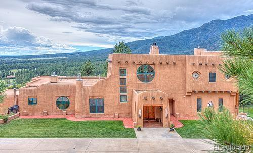 Spectacular custom mountain home with never ending views of the Greenhorn Mountains, foothills to the South, plains to the East. There are irrigated pastures with water rights, pine covered forest and spectacular bluffs. This is a one of a kind home with oversized 3 car, 2car garage,30x40 building.Private gated entry , custom wood doors with copper inserts throughout the home, Hardwood, stone and carpet floor coverings. Over 3000 square feet of outdoor living space, patios, decks and balconies. Top of the line kitchen appliances, custom cabinets and custom light fixtures. Wet bar in lower level media room. Less than 1 mile from San Isabel National Forest with miles of trails for hiking & horse back riding. Fishing and hunting abound in the forest. All sizes are approximate, Buyer to verify.