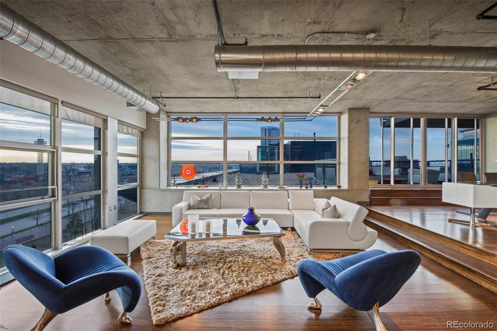 The moment you walk through the front door of this incredible loft in arguably the best building in downtown Denver, your eyes will immediately be drawn to breathtaking views of The mountains and Six Flags Elitch Gardens (soon to be River Mile)  outside of the floor to ceiling windows that surround the entire home. The expansive kitchen with large island and wide open living and dining area is the perfect space to entertain guests! Large outdoor patio and separate balcony with gas-line for a grill that over looks a park, the Cherry Creek bike and pedestrian path and the Pepsi Center. The bedrooms are on opposite sides of the 2401 sq feet of living space offering plenty of privacy for owner and guests. The master suite is separated from the rest of the home by a partial rotating TV wall to allow you to watch a show or a