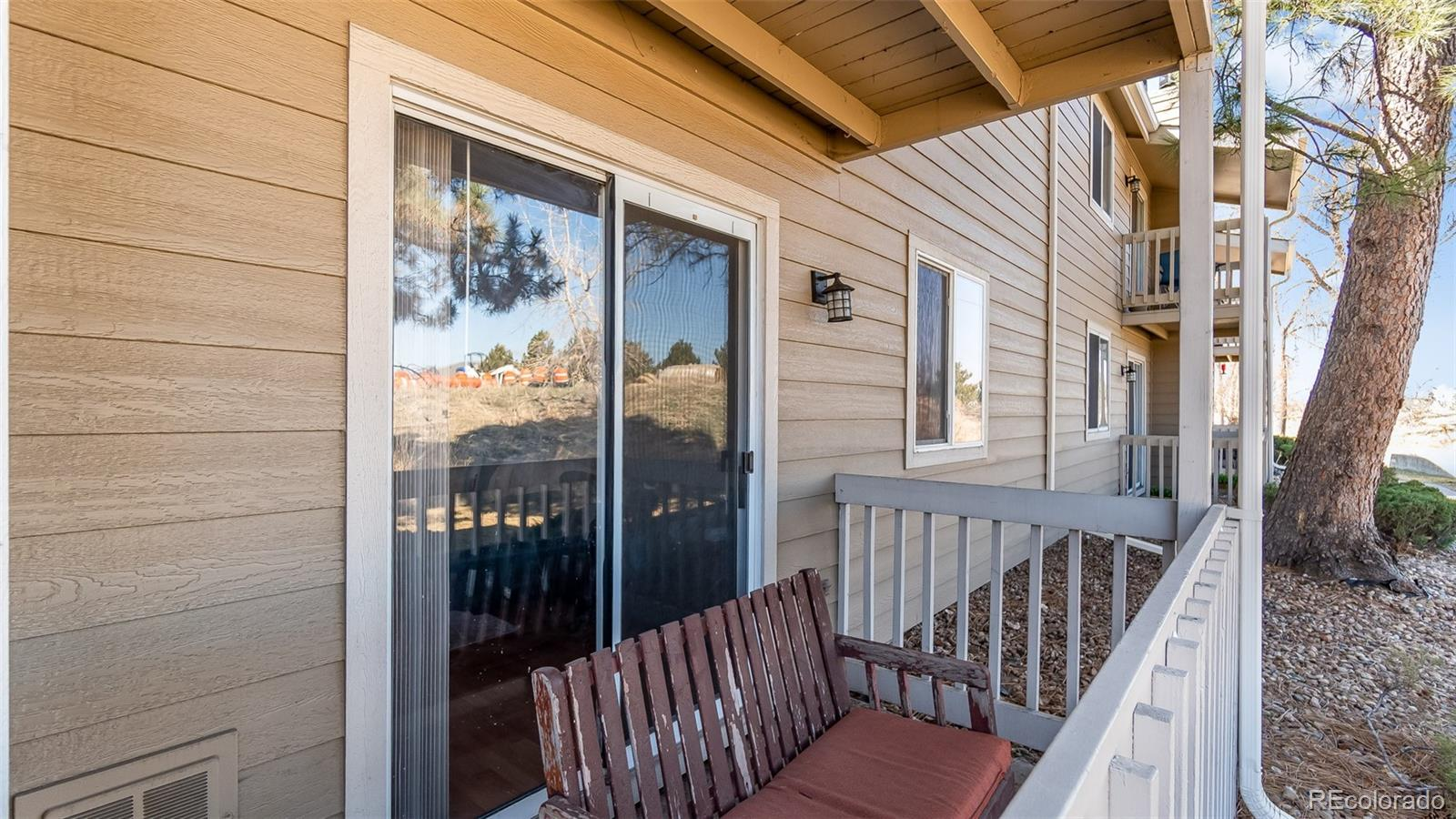 Ground floor unit located at the back of the building facing open space! New dishwasher, range and microwave in 2018. Refrigerator, washer and dryer also included. Wood burning fireplace, covered patio. Reserved off-street parking. HOA covers water, sewer and trash. 10 minute drive to Anschutz Medical Campus/University Hospital/Children's Hospital. Light rail R-line stop approximately 1 miles away. Walking distance to Heather Ridge golf course. Current lease ends 6/30/20.