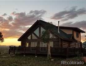 Long View RanchCustom log home situated on 160 gentle acres located 1.5 hours west of Colorado Springs. Overlooking 11 Mile Reservoir with unparalleled snow-cap views, this masterpiece three bedroom, two bath home is a true work of art designed with huge dovetail constructed 20 inch logs with hand-carved wildlife accents throughout. The perfect sportsman's retreat with trophy trout fishing on the world famous *Dream Stream* only 5 minutes away. The ranch is a short 3-mile drive to the one-million-acre Pike National Forest with over the counter elk tags for archery, 2nd and 3rd big game hunting season hunts. The 160 acres come with private land owner big game tag draw privileges.  is zoned agricultural with annual taxes under $1,200 per year, has year-round paved access, no HOA's, covenants or restrictions. The land provides the ability to build additional homes and three additional wells for livestock, irrigation, and household use.