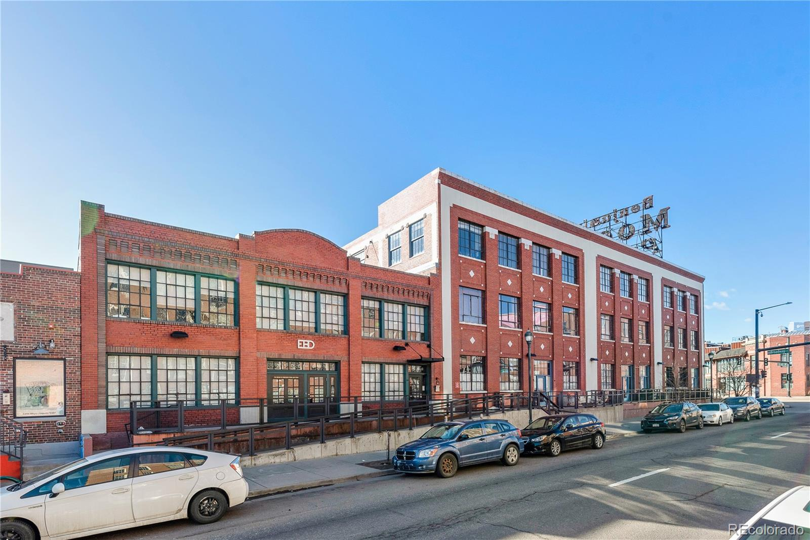 Are you looking for a historic brick loft full of character and light? How about secured parking with a reserved, covered space in River North (RiNo) - one of Denver's hottest neighborhoods? Wouldn't it be nice to have space not just for friends but two huge storage lockers for bikes, outdoor gear, and retro ski outfits too?! This isn't La-La Land, it's Unit 206 in the Historic Benjamin Moore Paint Building. Long home to a bustling facility symbolic of America's industrial might, Denver's sudden conversion from cow-town to thriving urban center, brought with it an iconic rebirth of the historic building. Purchased with the intent of creating a small collection of modern industrial lofts, the extensive rehabilitation produced superb results. The 2500 Walnut Lofts brilliantly balance the building's brick, concrete, and steel character with coveted elements of modern luxury - tall ceilings, huge windows, open designs, walk-in closets, and city views. After the rehab, the Sellers were one of the first in line and selected a northwest facing unit on the 2nd floor to ensure afternoon and evening light, a beautiful view of the brick clocktower across the street, and the peace and privacy that comes with being above the fray. They also added their own special touch - like a 2nd bathroom, a rarity in the building. Their decision - shortly after moving in -  to commission a local artist to design and build a breathtaking copper door - creates another feature unto itself. With it, the expansive living room can instantly transform into a guest bedroom, master suite, or mixed-use space. It's truly a sanctuary in the heart of the city. And should you tire of quiet solitude, and yearn for the company of friends, you'll be steps from the places you love to meet - the Denver Central Market, Osaka Ramen, First Draft Taproom, Lustre Pearl, Patagonia, Big Power Yoga, Los Chingones, and more. They say there's no such thing as perfect, but this unit just might be!