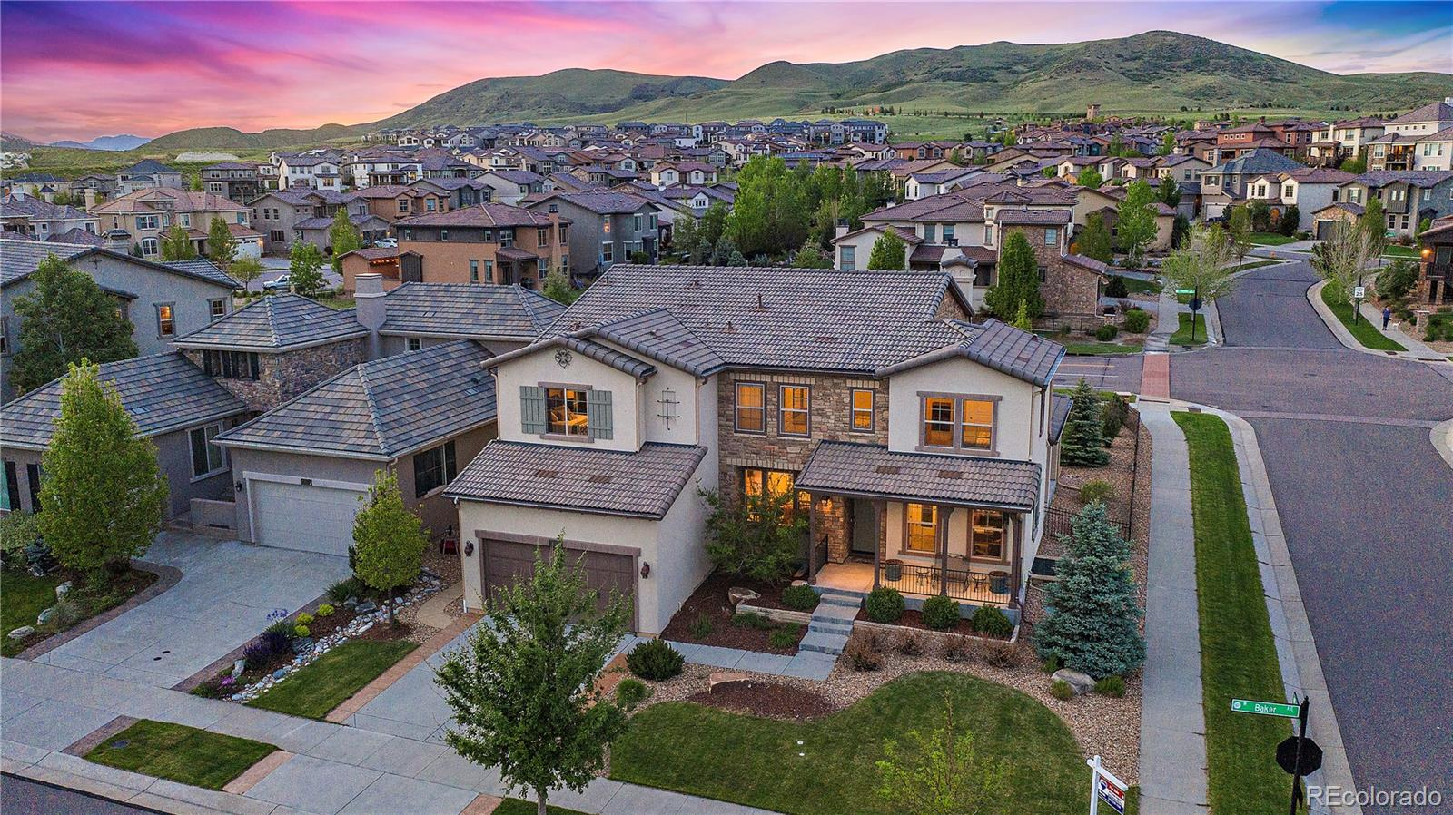"""Infinity Home Collection Vita Plan 570 in Solterra Colorado! Here is your opportunity to Own an Infinity Home on a 10,000+ sq ft large corner lot .Only one neighbor to the West and NO neighbors behind the home.Soaring, light-filled space lends a dramatic impact upon entering this spectacular home .The Vaulted Great room with Stone fireplace is filled with ample amounts of natural light. Main floor features a private office with french doors , built ins and addtional recessed lighting. Formal Dining room is private and also has addtional recessed lighting with a butler's pantry with tile back splash.The large chef's kitchen features a Sizeable Kitchen Island, Gas Cook top , Double Ovens , Tile back splash and under cabinet lighting. This home has a covered private patio that leads to a substantial flat private fenced back yard with an addtional Stamped Concrete patio area. Fully landscaped front and back yard.3-car garage-perfect for storing all your recreational equipment. Minutes to Bike/Hike Green Mountain, Bear Creek Lake Park and Red Rocks Park .Many community events at the Solterra Retreat. Infinity Home Collection Screams Quality - don't miss out on this home and location.If you would like a """"live tour"""" through Zoom/Skype/Facetime-please contact Listing Agent."""