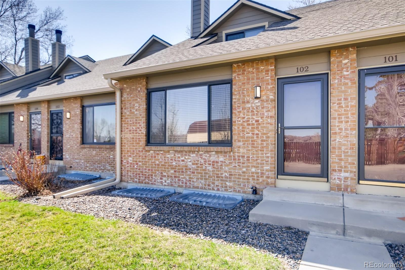 Pre-sale Inspection report available.  3D matterhorn tour at https://listing.virtuance.com/listing/10694-w-63rd-pl-102-arvada-colorado/ Completely UPDATED and ready to move in! NEW KITCHEN with slab granite and glass backsplash, BRAND NEW carpet, NEW paint, all bathrooms updated with 2 bedrooms/ 1 bathroom on upper level and 1 bedroom/ 1 bathroom in the basement (non conforming). All appliances included, plus washer & dryer, and fenced PRIVATE patio (1 pet per HOA allowed), central A/C and 2 reserved parking spaces included.  This is the home you've been waiting to make yours!