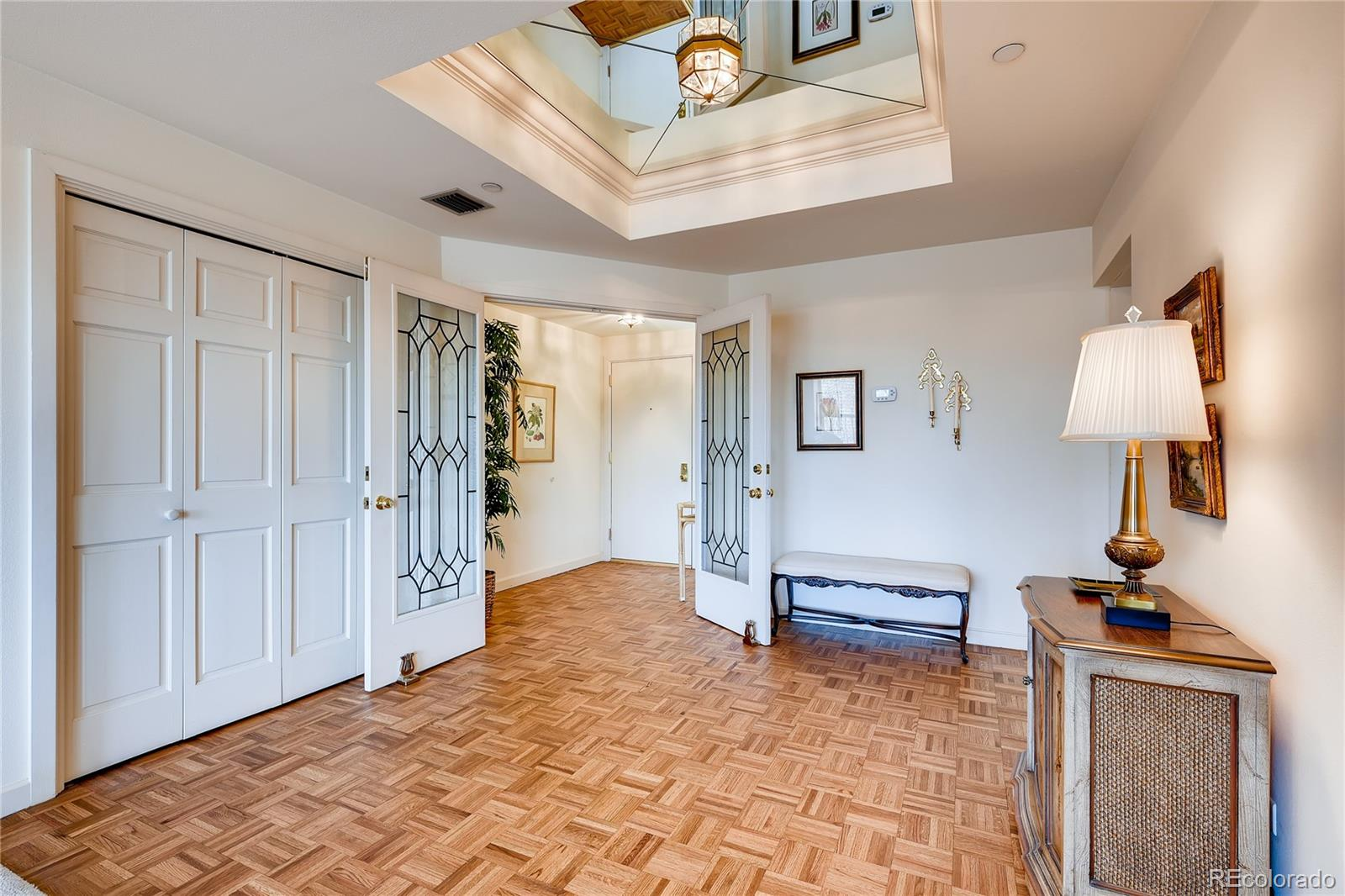 Elegant south facing unit of 2390 square feet with floor to ceiling windows overlooking acres of manicured landscaping, ponds, waterfalls, trees and stunning mountain views.  Lovely parquet wood floors, plantation shutters, crown molding, coffered ceilings, wet bar and spacious rooms. Gracious living and beautiful appointments.  Impressive entry with Deco French doors into Great Room and dining area.  All appliances included in kitchen with upgraded lighting and large eating nook. The two bedrooms and full baths could be dual masters or an office/den. Nice storage in  Laundry room equipped with full sized washer/dryer.  There are two deeded parking spaces and large storage unit. Fitness Center with indoor/outdoor pool, hot tub, steam rooms, racquetball courts, picnic area with grill and party room with kitchenette. Grand Salon with peaceful north facing large brick patio and guest suites also available.  Waterford is a great living experience with 24/7 manned front door.  Three elevators.  Cherry Creek schools.  Pet free building.  Underground garage is heated and well-lit.  Live like being on a vacation every day.