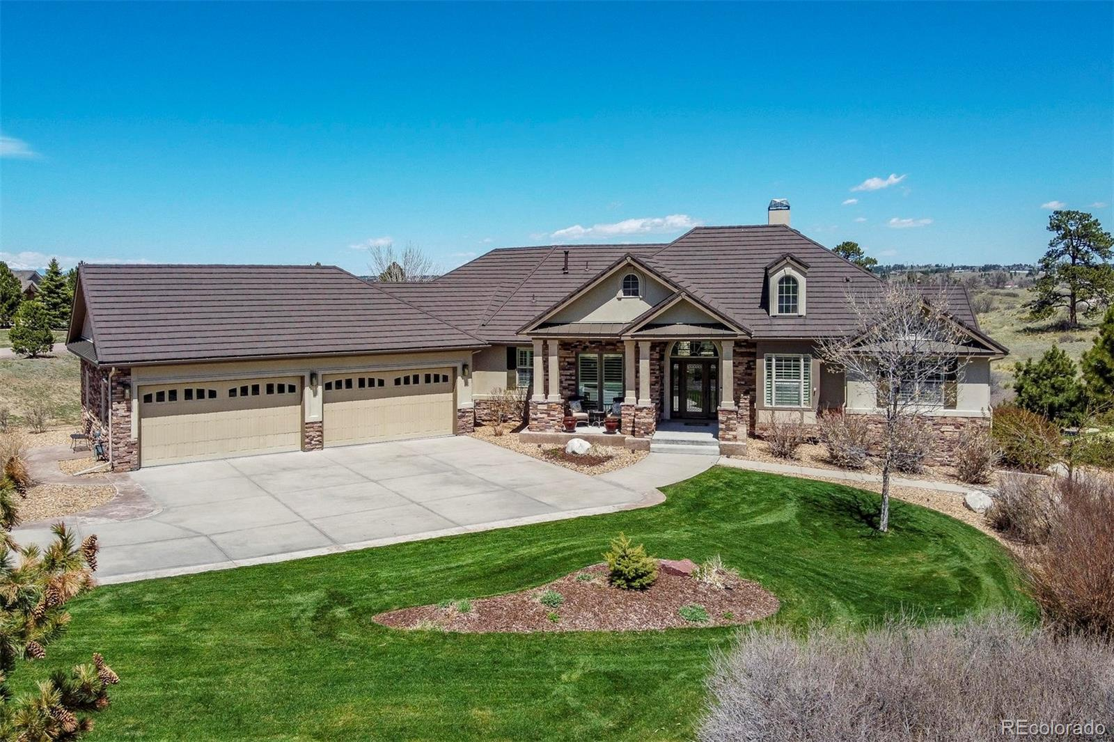 Beautiful, custom ranch on 1.5 acres with serene views! This 6 Bedroom, 6 Bathroom sprawling ranch is updated throughout. Enter through the Foyer to enjoy  the Great Room that allows for an abundance of natural light, hard wood floors and built in shelving. The Kitchen is updated with 42