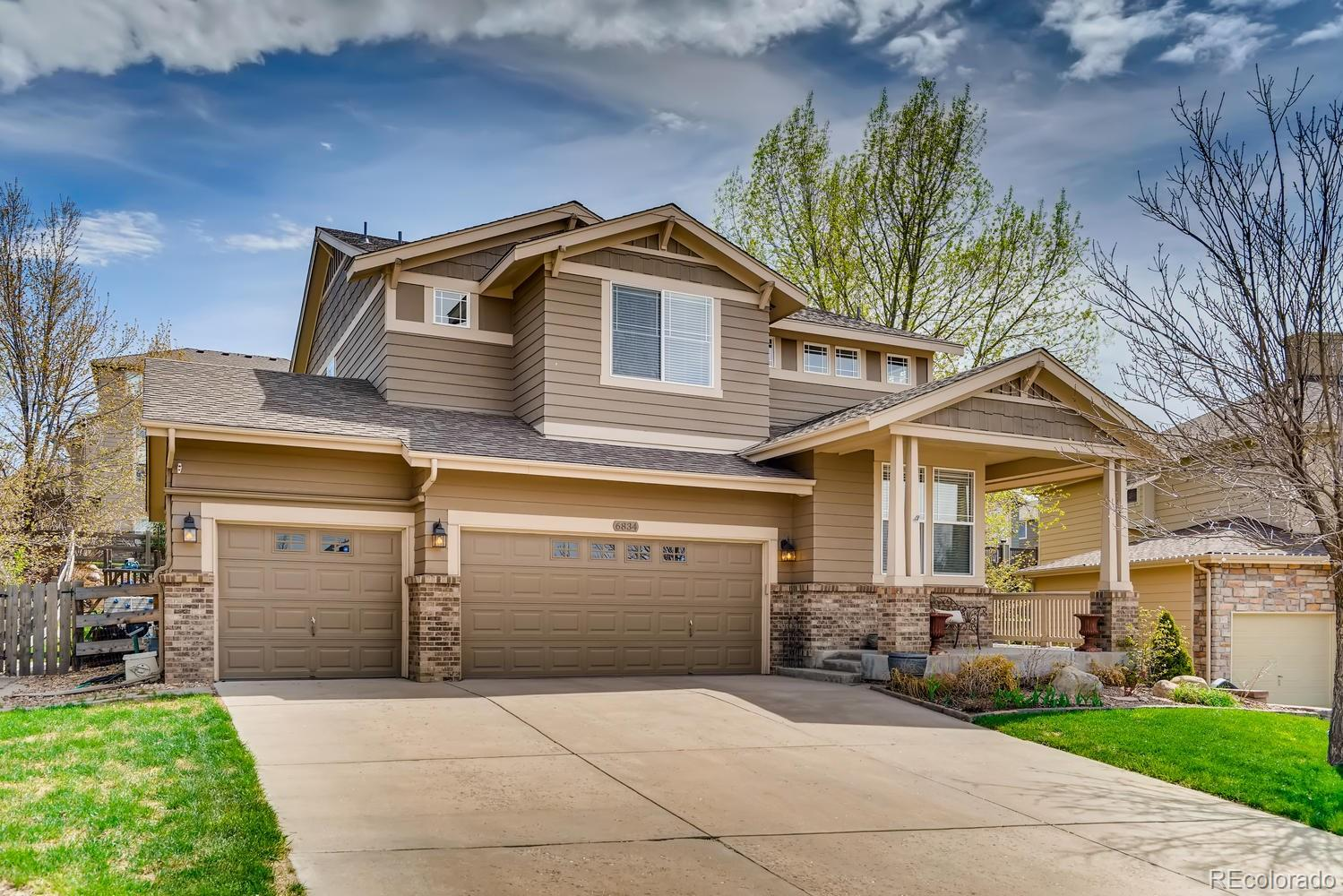 Welcome to your beautiful home in the Castle Pines North neighborhood! Located on the corner of an elevated cul-de-sac, it provides peaceful relaxation and beautiful views of the mountains and DTC.  This recently updated home feels fresh and modern with beautifully finished hard wood floors and newer paint throughout the main level. The open floor plan, with an abundance of natural light, is warm and inviting. Your updated kitchen is a chef's dream and perfect for entertaining; complete with cherry cabinets, granite countertops, stainless steel appliances, large island, and inlayed tile backsplash.  As you step outside, a spacious backyard awaits with a new paver patio, a custom designed sitting area, and mountain views. Other features include new water heater, master suite with mountain views, a large upstairs loft and a massive three-car garage with ample storage for bikes, tools, and all your toys.  You're just a short walk from numerous neighborhood amenities, such as the pool/clubhouse, Coyote Ridge Park, community events/music festivals, miles of trails for biking and hiking, and Daniel's Gate park. There's always something to keep you busy!  The central location provides easy access to I-25, C-470, DTC, and downtown Denver.