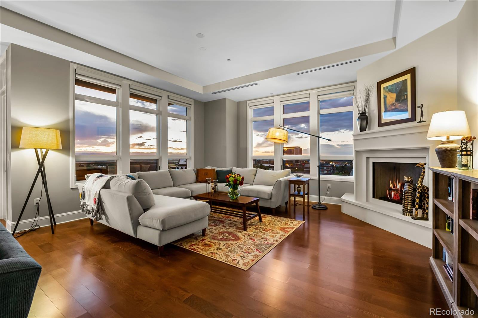 Large two bedroom residence on West side of the West Tower with views of the Mountains and Downtown Denver.  Located in the Northwest corner, it is very private with an abundance of natural light. The living area is very spacious and allows for several seating variations with a unique and beautiful corner fireplace.  Plenty of counter space in this large kitchen with GE Monogram Appliances like cooktop, oven, microwave/convection, refrigerator and dishwasher. There are two balconies with the main balcony facing West and the second balcony off of the master bedroom. Master suite is complete with large walk-in closet and 5 piece bath. Secondary bedroom is adjacent to the second bath and laundry area. Second bedroom is currently being used as an office or create another office space in the extra large living area. The residence comes with 2 assigned parking spaces #139 and #140 and garage level storage locker. The wine storage locker is located in the main floor, temperature controlled wine room. Enjoy all the luxury amenities The Landmark has to offer including concierge, 2 fitness centers, 2 pools, 2 spas, sauna/steam, 2 business centers, party room, library, guest suites and much more. No need to travel too far for great restaurants, entertainment and exercise venues, as the Landmark retail area has it all. To view the virtual tour with floor plan please visit: https://tours.muntzstudios.com/1605225
