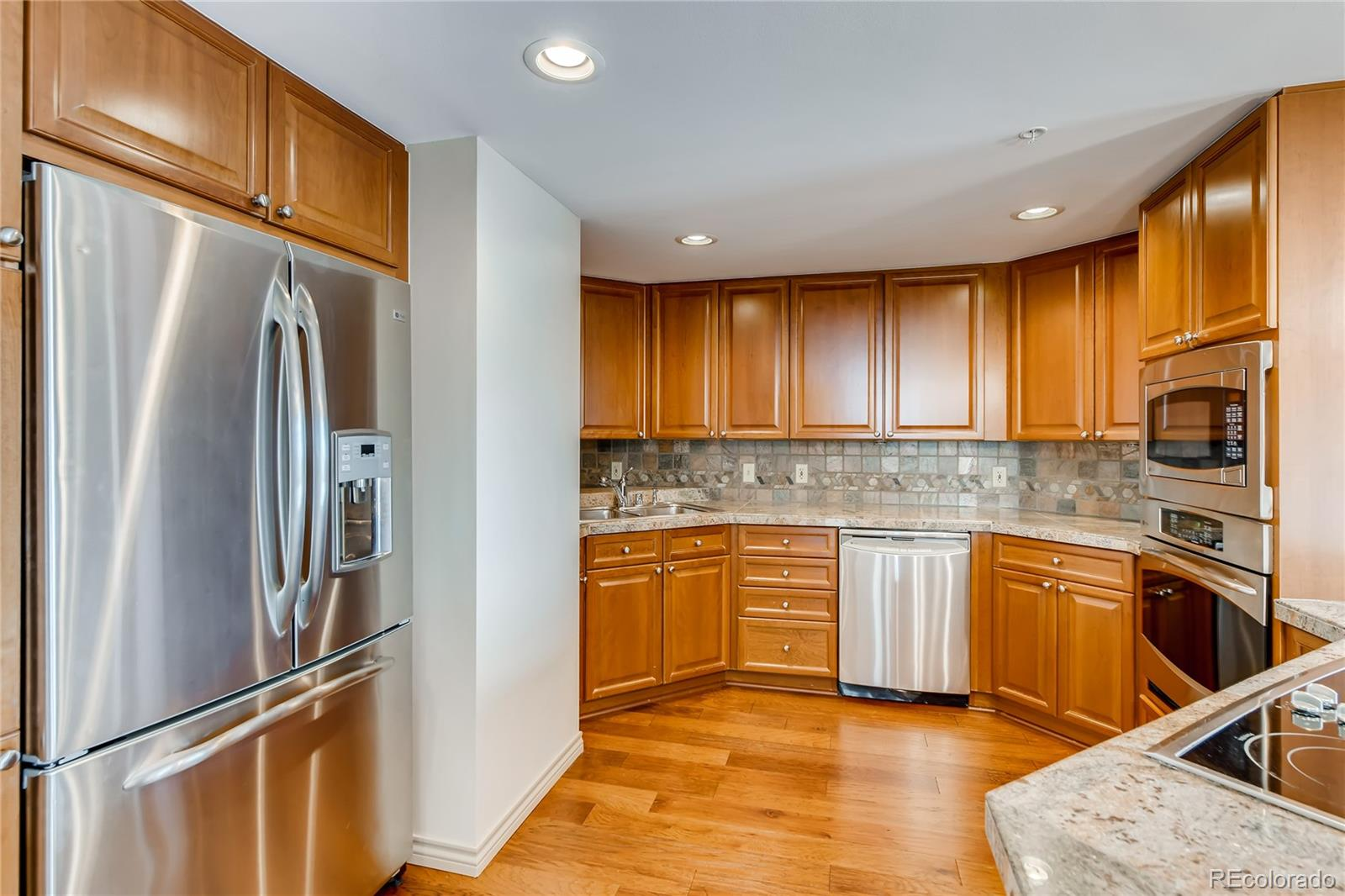 Newly updated!!!! Don't miss this beautiful two-bedroom, two-bathroom condo located in the heart of the Denver Tech Center. Just minutes from I-25 & I-225, public transportation, parks, restaurants, shopping, Cherry Creek State Park and DIA. The unit offers large bay windows with amazing views of George Wallace Park and the DTC clock tower.  Bedrooms perfectly placed on opposite sides of the unit allow for an open and airy flow with plenty of room for entertaining. Master suite includes a large walk in closet and a floor to ceiling sliding glass door that opens to the patio. The patio offers two entrances from both living room and bedroom perfect for enjoying the views and grilling. Kitchen is equipped with GE Profile stainless Steele appliances and plenty of storage. Kitchen and bathrooms offer granite tile counter tops. Laundry room with stackable washer and dryer included. Unit includes one deeded garage space 15 feet from building entrance. Garage also allows access to one large extra storage unit. Building is safe and secure with electronic doors only accessed with fob and onsite staff. Amenities include concierge, work out facility, business center, conference room and party room.
