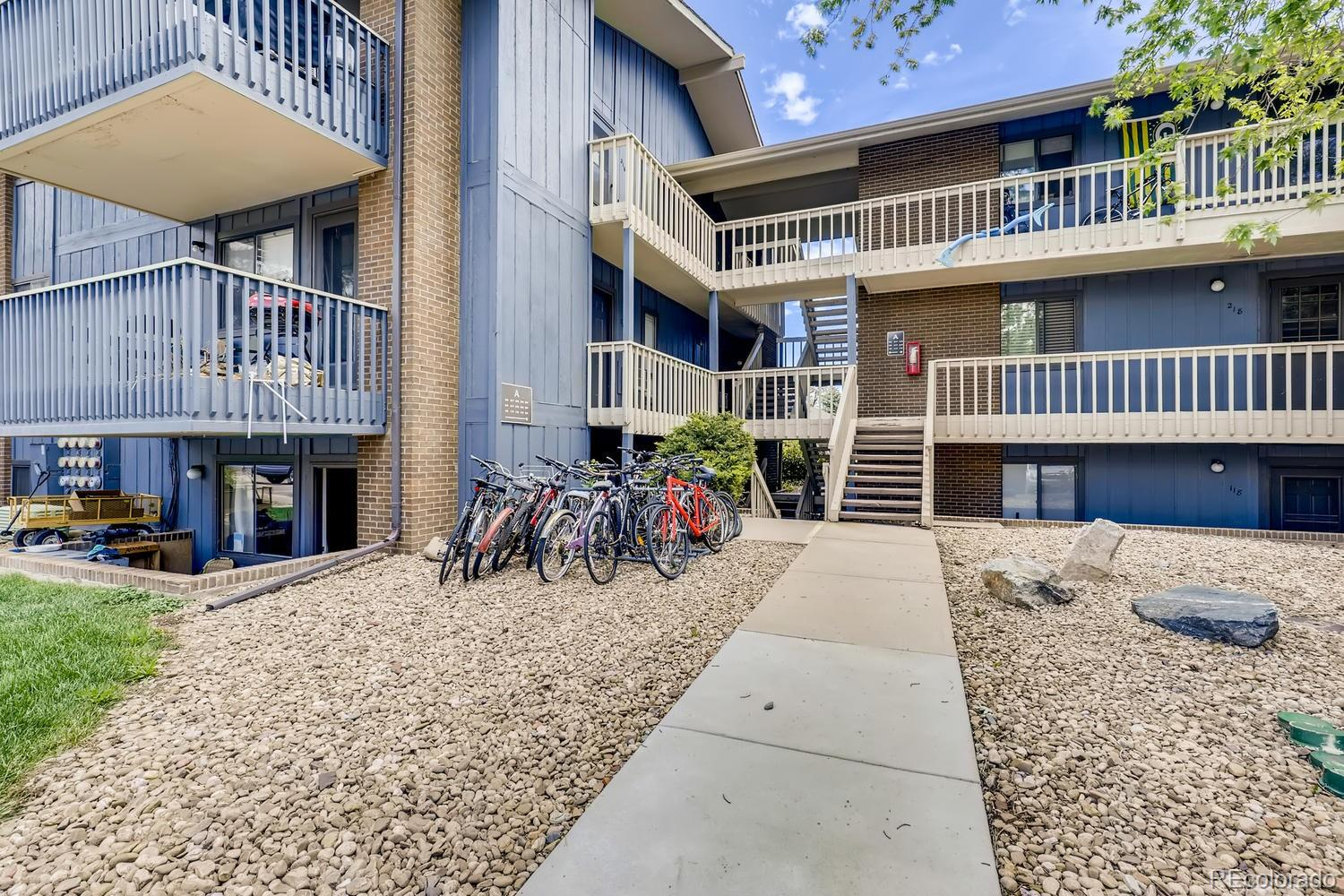 Cute condo in Boulder features 2 beds, 2 baths, living room, kitchen, in-unit laundry and carport parking space. Unit overlooks a biking/jogging path.  Great for yourself or as an investment property. Neutral tones throughout.  Ceiling fans and wall unit air conditioning keep the unit comfortable on those warm summer days.  The living room features a wood burning fireplace.  Wood laminate flooring in main living areas, carpeting in the bedrooms.  HOA covers heat & hot water, natural gas  (central boiler technology), pool, central showers, clubhouse & grounds. Bike path makes it easy to get around.  Great location - close to dining, shopping, entertainment and other amenities.