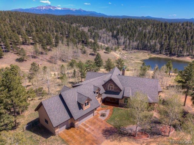 51+ Private Acres Close to Town ~ Pond w/ Water Rights ~ Twin Creek Frontage ~ Pikes Peak & Sangre Views ~ Custom Home w/ High-End Features & Main Level Living ~ Loft & Lower Level w/ add'l Living Space ~ Guest/Rental Home (3BR, 2 bath) ~ Morton Barn (Electric, Water, Heat, Concrete Floor, Workbench) ~ Geodesic Greenhouse & Raised Planting Beds ~ Mature Aspen, Pine, Spruce & Fir ~ Perimeter & Cross Fence ~ Livestock Friendly ~ No Covenants or HOA ~ Close to Nat'l Forest ~ County Road Access ~ Natural Gas ~ Mineral Rights Extras: Water & Mineral Rights. Numerous Inclusions & Exclusions – list available from Listing Agent. Buyer may negotiate and purchase directly from Seller selected items from the Sellers Exclusion List (to be completed outside the sale of the Property).