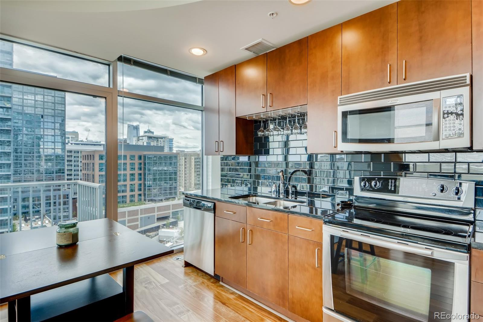 This beautiful Glass House Condo located in the desirable Riverfront Park neighborhood, is the perfect place to call home. The location is second to none with excellent walkability to the best restaurants, bars, grocery stores and shops in Denver. The open floor plan is the perfect place to entertain friends and family and you can impress them with the gorgeous views of Downtown and the mountains from your balcony. The Glass House has the best amenities in town with a secure entrance, 24 hour concierge, a complimentary continental breakfast on Saturday and Sunday's, Exterior window washing, maintenance staff to help with all of your needs, and so much more. Make sure to check out the fitness center, pool, business center, and year round access to the gas fireplace and grills on the 8th floor! There is UV window tinting applied to eastern windows to help with energy efficiency and sun glare. There is so much to do in this neighborhood and you are steps away from Coors Field, Broncos Stadium, and Pepsi Center. Don't miss out on your opportunity to own in the Glass House!