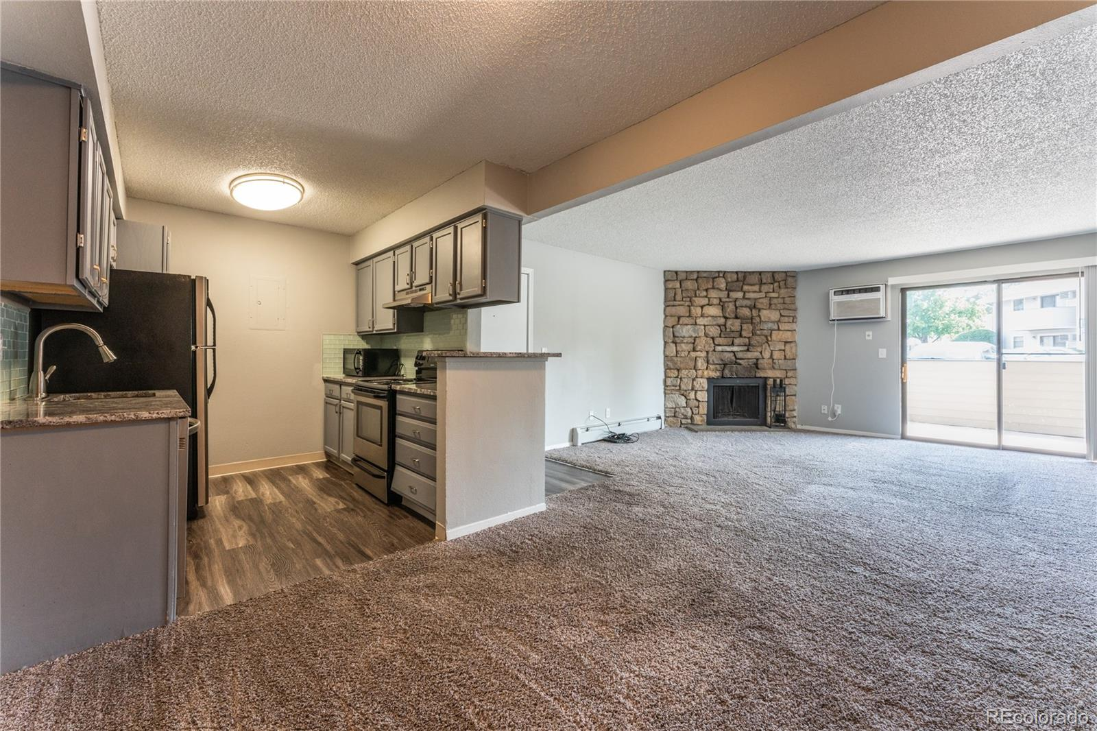 Charming and freshly updated ground-level 2 bedroom/2 full bath condo in Lowry Denver area, a beautiful gated community! Large Master Suite w/Walk-in Closet & Full Bath. Large cozy living room with wood burning fireplace. Kitchen includes granite countertops, tile back splash and stainless steel appliances. Laundry hookups in the home. **Brand New Windows** Enjoy the private covered patio and easy access to your unit via a deeded parking space! HOA includes water, heat, trash, 24hr security cameras, and basic cable too! There are numerous private amenities (pool, playground, clubhouse and parks). The proximity to restaurants, shopping and public transportation makes this Denver condo the ideal place to call home, set your private showing today!Property has been professionally cleaned, Please see supplements for all COVID-19 Compliance Docs that will need to be filled out and signed prior to showing the unit. Hand Sanitizer and  Masks available if needed.