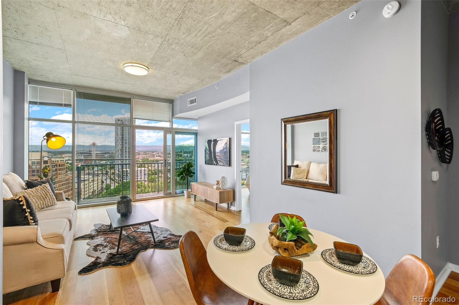Wow - floor to ceiling windows in the living room AND the bedroom AND a private balcony all offering an incredible, expansive view of the wide open blue sky, snow capped mountains and the lush green way of Riverfront Park!  This 16th floor unit is the luxurious home you've been seeking in Downtown Denver.  Walk to everything! Or, if you don't want to leave home, enjoy all the amenities the Glass House has to offer: 24 / 7 concierge service, huge fitness center including Pilates reformers, free weights, cycling rooms, cardio area, and a massive cross-training room.  The eighth floors connect the two towers together by a large community room with multiple seating areas, a movie room, a business center, and a coffee station.  Additionally, there is a full-size swimming pool and fire pit with grills.   Walk steps from the entrance of the building to explore 23 acres of Green space as you stroll through Riverfront Park.   Set between the skyline of the Central Business District and the tree lined shores of the South Platte River this is the perfect place to relax, right outside your front door.  Punctuated by an off-leash dog park and weekend picnickers, Riverfront is a gem of a park with an urban vibe.    Back inside unit #1605, this one bedroom, one bath condo offers comfort and modern living in a loft high above it all.   The home is flooded with natural light because of the southwest facing floor-to-ceiling windows. The spacious, updated kitchen features stainless steel appliances, granite counter tops, contemporary fixtures, a handy kitchen island and sleek subway tile. The master bedroom has a large walk-in closet as well as an en suite bathroom.  This unit includes a reserved parking spot, a storage unit and one of the best private balconies in all of Denver.     This one is worth your time to check out - a home for all the seasons to come.