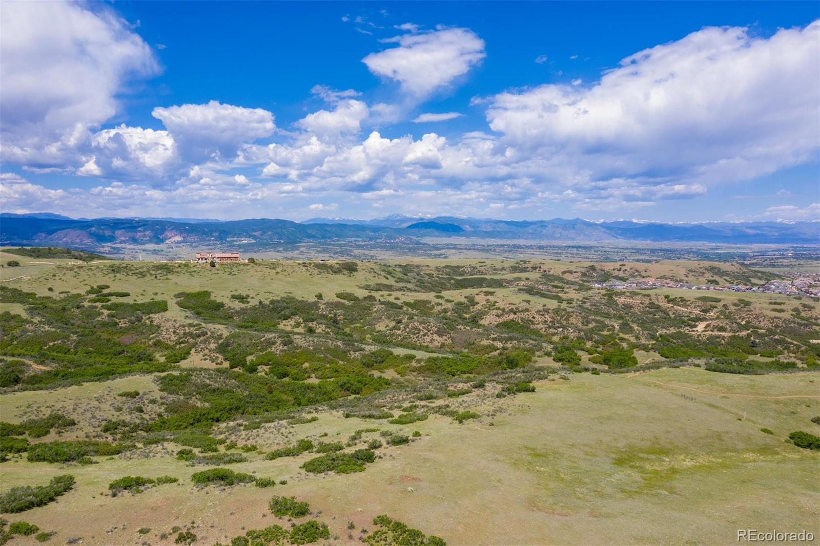 The last, best, and only - beyond phenomenal home site in one of Douglas County's most pristine gated communities. 36 sprawling acres are exquisitely set atop a mesa where mountain views dominate the horizon from Longs Peak all the way to Pikes Peak. An ideal setting on which to build your ultimate Colorado retreat, don't let this exclusive opportunity pass you by! The natural landscape is the quintessential playground by day, and the sparkling stars over the Front Range is the perfect backdrop for unwinding at night. This rare lot is located in Tessa Mesa, a gated community of only sixteen estate sites averaging 35 acres. Access to I-25 is quick for easy commuting to Denver or Colorado Springs, and the community is only two miles northwest of the historic town of Castle Rock. The immediate area is home to 320-acre Phillip Miller Regional Park, the Promenade shopping district, and miles of bike and walking trails. For more outdoor entertainment opportunities, there are numerous golf courses in the area and the community offers equestrian easements for riding between properties. Witness this impeccable landscape for yourself and envision your dream estate coming to life! Check out the property video under the Virtual Tour tab.