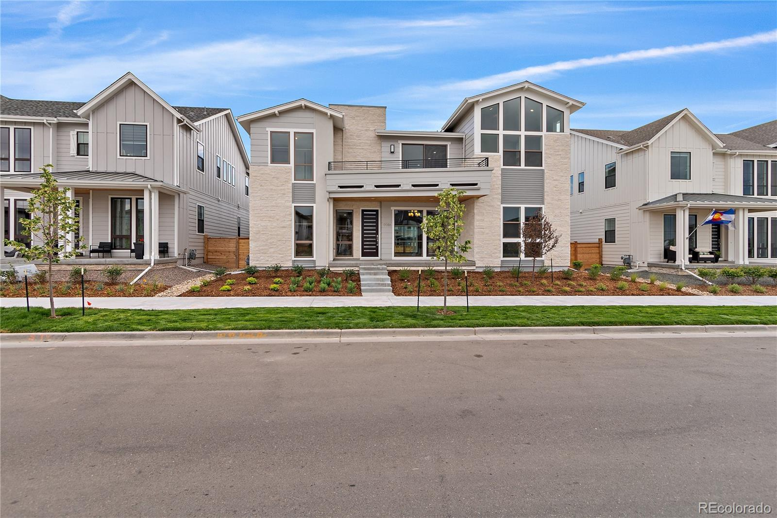 """Soaring, light-filled space lends a dramatic impact upon entering this spectacular LUXE 2 home. A main floor bedroom suite offers flexibility, quiet privacy and multi-generational needs. And seamless transitions from indoors to out increase the already generous square footage in an impressive way.  The large chef's kitchen features high-end Thermador appliances, including separate fridge and freezer columns, as well as a 48"""" range top.  Sophisticated cabinetry and upgraded quartz completes a dream kitchen.   Beautiful hardwood floors cover significant portions of the main level and extend up the stairs and into the master bedroom.  The spa-like master bath features separate vanities, multiple shower heads and a massive walk-in closet with built-ins.  Ready for immediate move-in, this luxurious urban estate is located within steps of Stapleton's newest pool and park"""