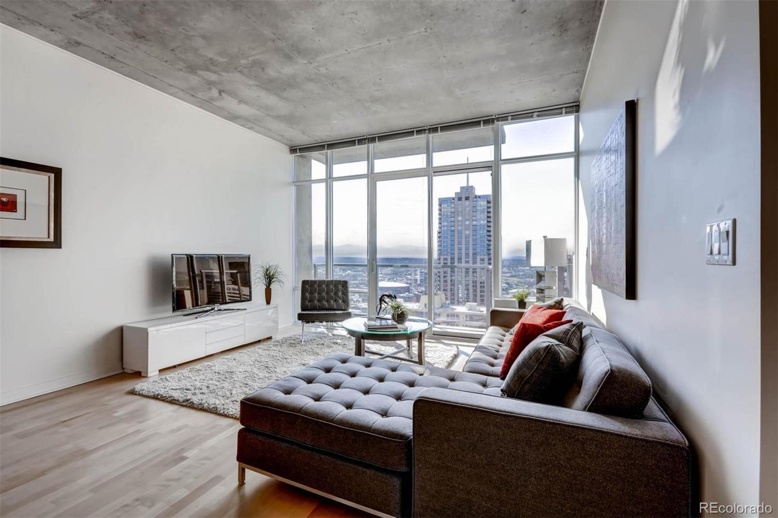 AWAKEN EACH DAY TO BREATHTAKING VIEWS OF DOWNTOWN AND BEYOND!  This is a great value -- You can't go any higher up at SPIRE and find a better-priced 1-bedroom home available.  This 37th floor, 1 bed/1 bath condo has a rare floor plan, featuring walls of glass in BOTH the living room AND the bedroom! This residence includes upgraded appliances and finishes, and some of the most spectacular views in Denver. Direct views of downtown's soaring skyscrapers, Elitch Gardens, the Pepsi Center, Mile High Stadium, and the Rocky Mountains. This home also comes with access to the exclusive SkyClub lounge in SPIRE's 42nd-floor penthouse. Also included are 1 deeded parking space & 1 storage unit in the attached garage. The 42-story SPIRE is LEED-certified, with 40,000 sq ft of awesome amenities, including a rooftop pool and hot tub which are heated & open year-round,  extensive health club, The Zone multimedia lounge, the Box Office multimedia theater, garage dog park, yoga garden, outdoor grilling area, 10th-floor private event lounge, 24-hour courtesy desk, fully-furnished SPIRE guest suites, special accommodations for electric vehicles, and modern security & access control systems. Very well-maintained building! SPIRE Denver has fast internet coming soon-1 gig dedicated to each condo. Fastest downtown! Your new home is in the heart of it all. SPIRE is conveniently located at 14th Street & Champa Street. You can stroll or grab the free shuttle to Larimer Street restaurants, downtown's night life, the Colorado Convention Center, Denver Center for the Performing Arts, Denver Pavilions, Whole Foods Market, the emergent Union Station neighborhood and the A-Line train to Denver International Airport.  Come home to Downtown Denver's SPIRE -- life is better here!