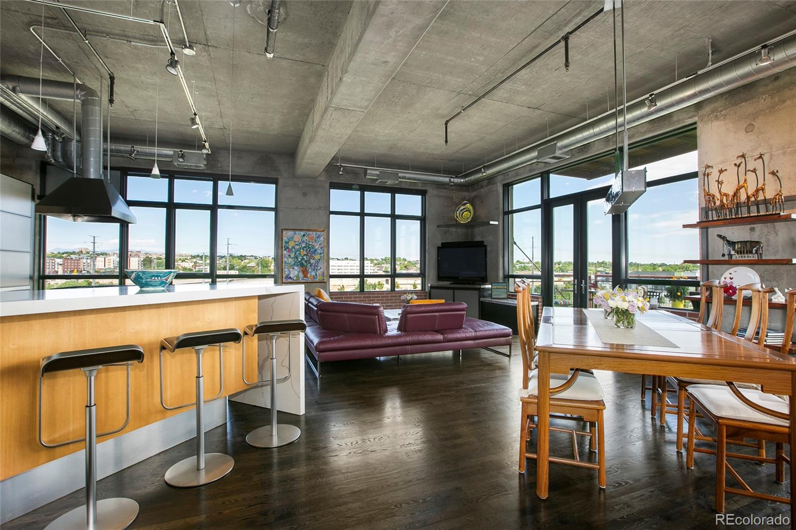 A rare opportunity in Denver's historical Flour Mill Lofts developed by Denver's Dana Crawford (of Crawford Hotel@Union Station). The end unit is bright w/large windows on 3 sides that include views of COLO mountains, Platte River, Cuernavaca Park, & Denver's skyline. It lives extremely lg with its open floor plan. Crawford's vision is seen throughout with exposed brick, walls and ceilings. Soaring 12ft+ ceilings. The kitchen boasts SUBZERO frig, 2 DACOR ovens, European electronic door cabinets/coffee bar & glassware storage. 180+ bottle wine frig, Master closet is floor-to-ceiling built in hanging & storage. Master bath has 2 ROBERN lighted interior/exterior cabinets, NEOREST electric toilet, NAKORI soaking tub, walk-in shower, and NEOLITH marble wall panels, plus lighted art niches and motion floor lighting! NEST thermostats. Custom wall covering in entrance hall. Outdoor balcony is 192 sq ft. w/natural gas. FML is secured & provides ample visitor parking. Herb garden for residence and high speed internet. Pet friendly.